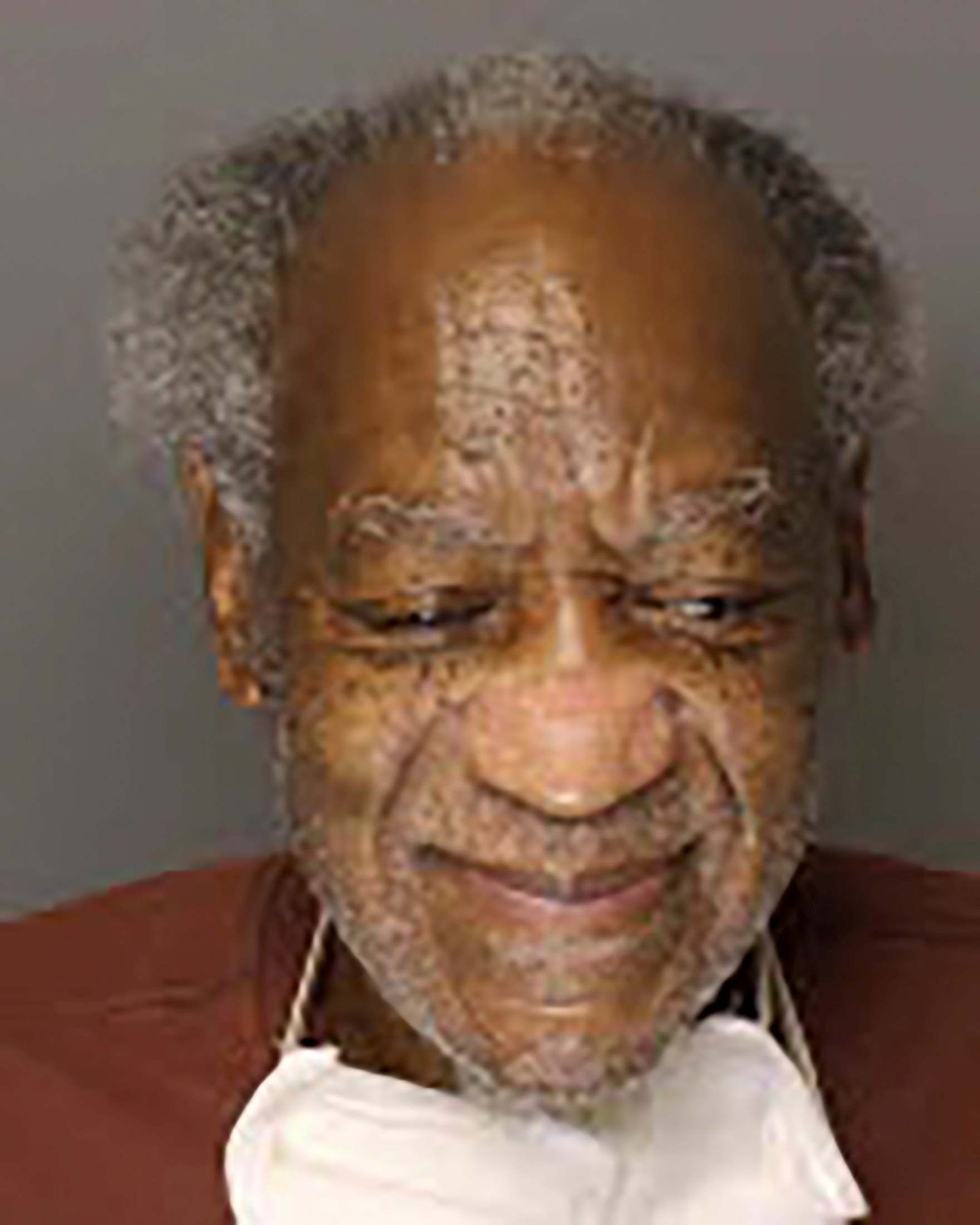Actor and comedian Bill Cosby poses with a mask under his chin in a photograph taken at State Correctional Institution (SCI) Phoenix in Skippack Township, Pennsylvania, U.S. September 4, 2020.Pennsylvania Department of Corrections/Handout via REUTERS