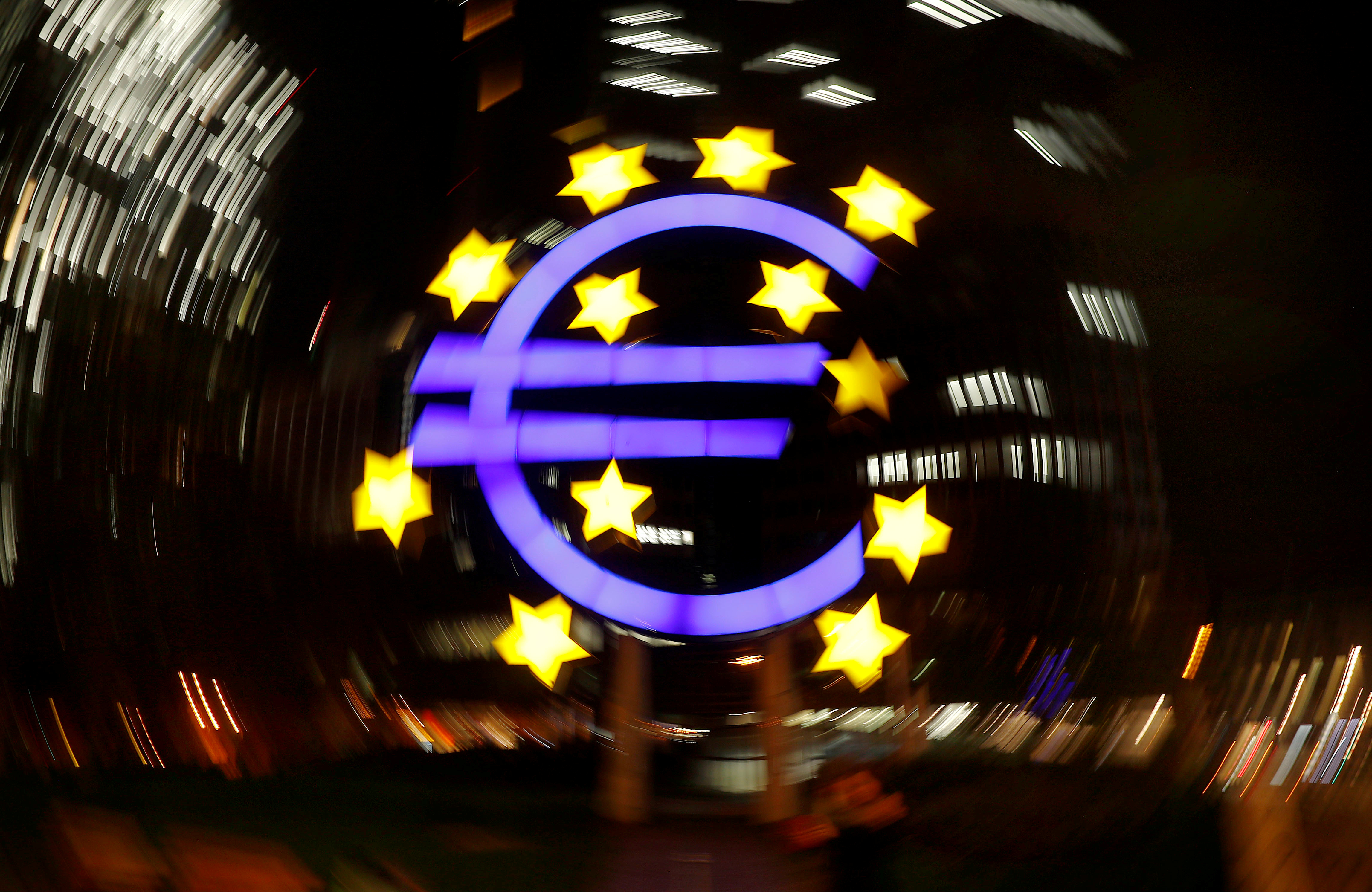 The euro sign is photographed in front of the former head quarter of the European Central Bank in Frankfurt, Germany, April 9, 2019. Picture is taken on slow shutter speed while the camera was moved.  REUTERS/Kai Pfaffenbach/File Photo