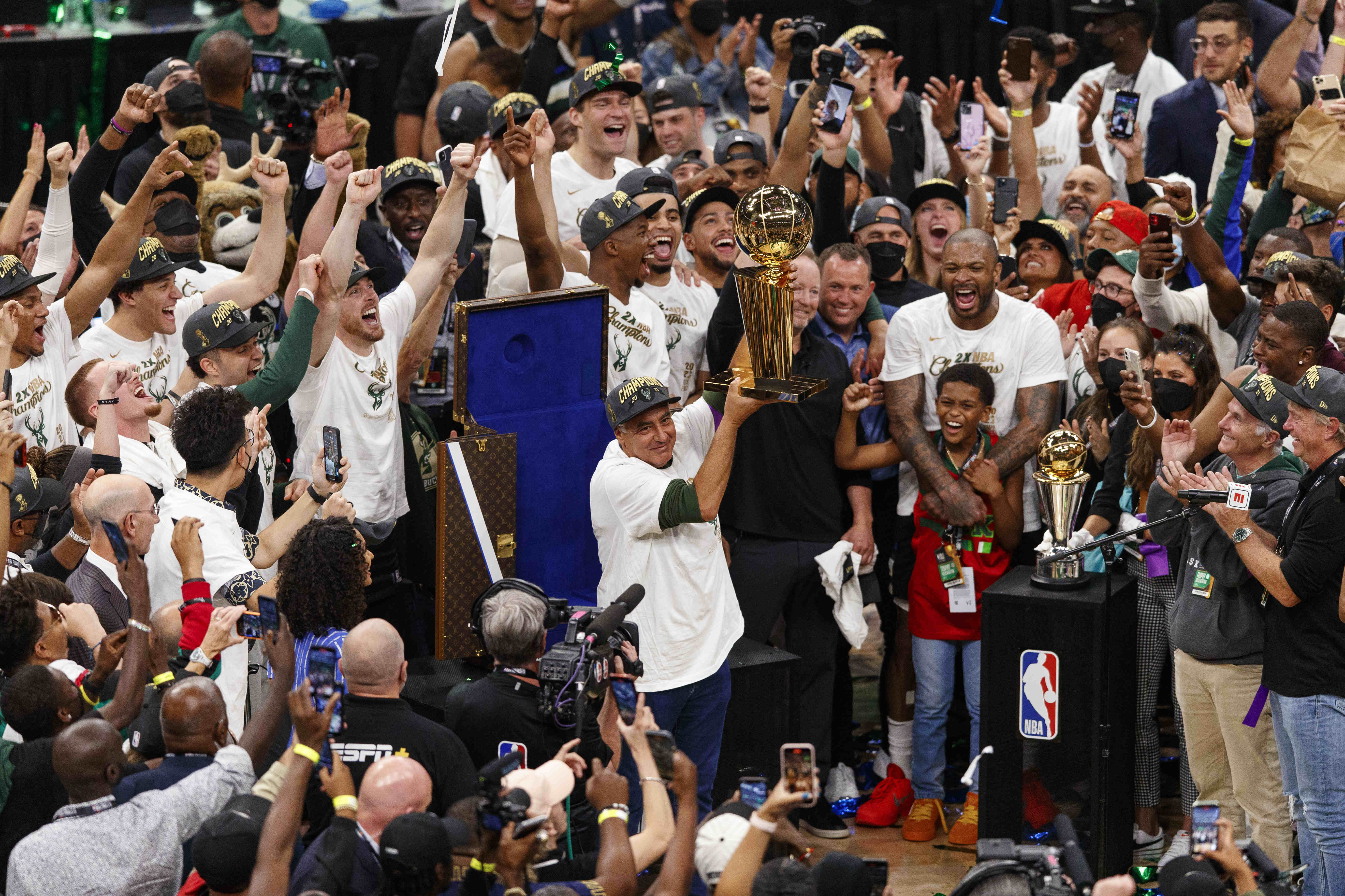 Jul 20, 2021; Milwaukee, Wisconsin, USA; Milwaukee Bucks owner Wes Edens holds up the Larry OÕBrien trophy following game six of the 2021 NBA Finals agains the Phoenix Suns at Fiserv Forum. Mandatory Credit: Jeff Hanisch-USA TODAY Sports