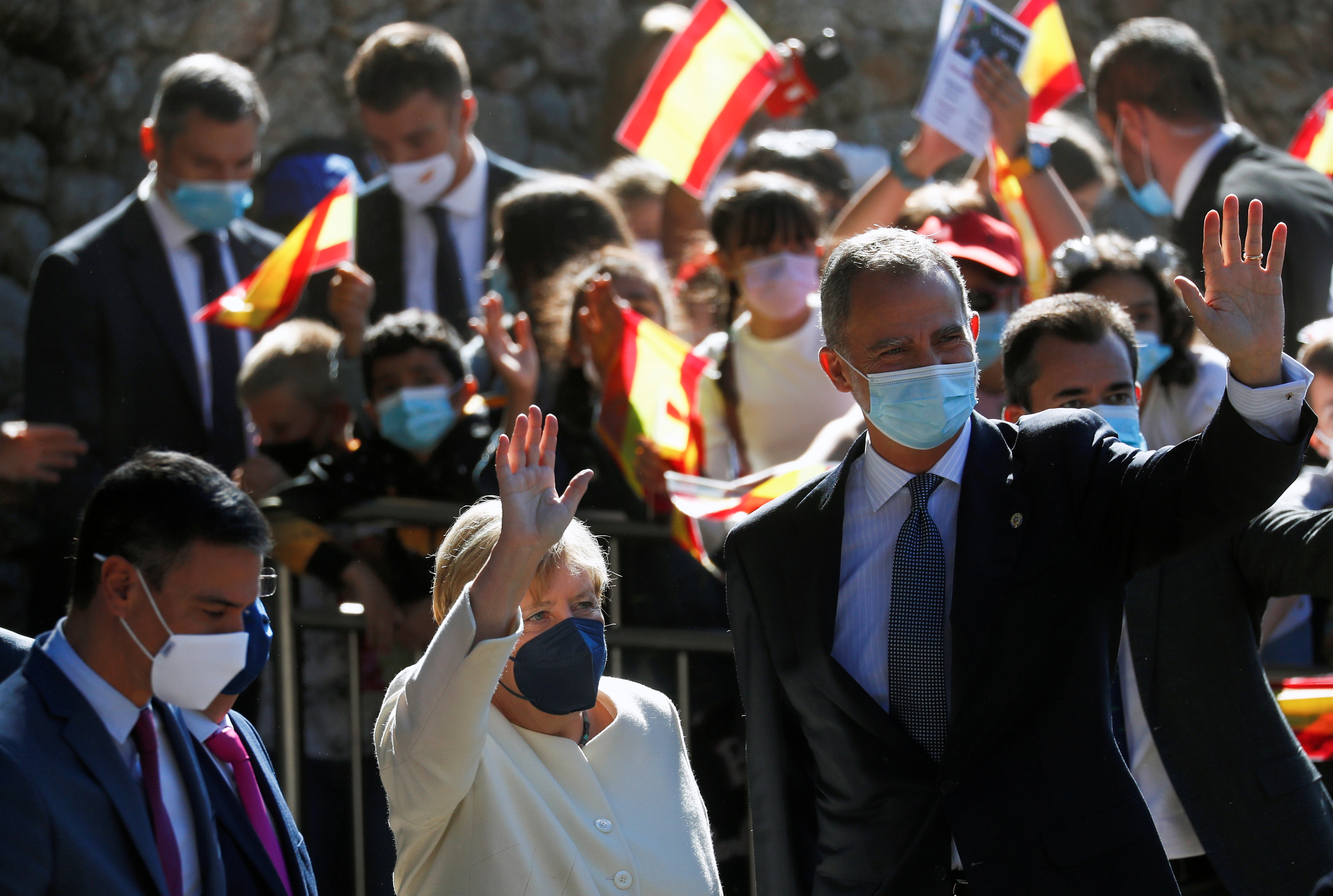 Spain's King Felipe, Spain's Prime Minister Pedro Sanchez and German Chancellor Angela Merkel meet upon her arrival to receive the