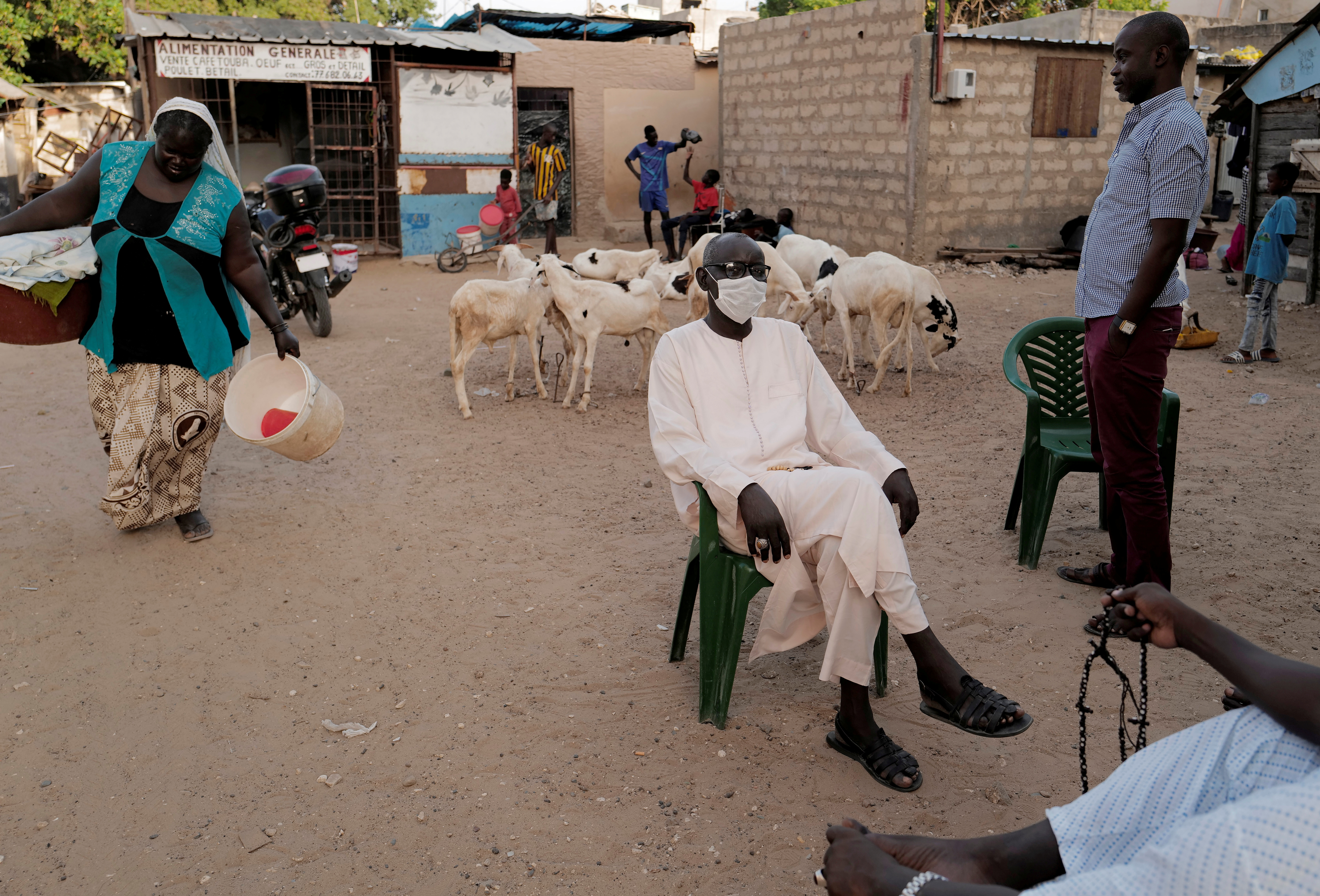 A man wears his protective mask while sitting outside his house, as the global spread of the coronavirus disease (COVID-19) continues, in Ouakam neighbourhood of Dakar, Senegal October 23, 2020.  REUTERS/Zohra Bensemra/File Photo