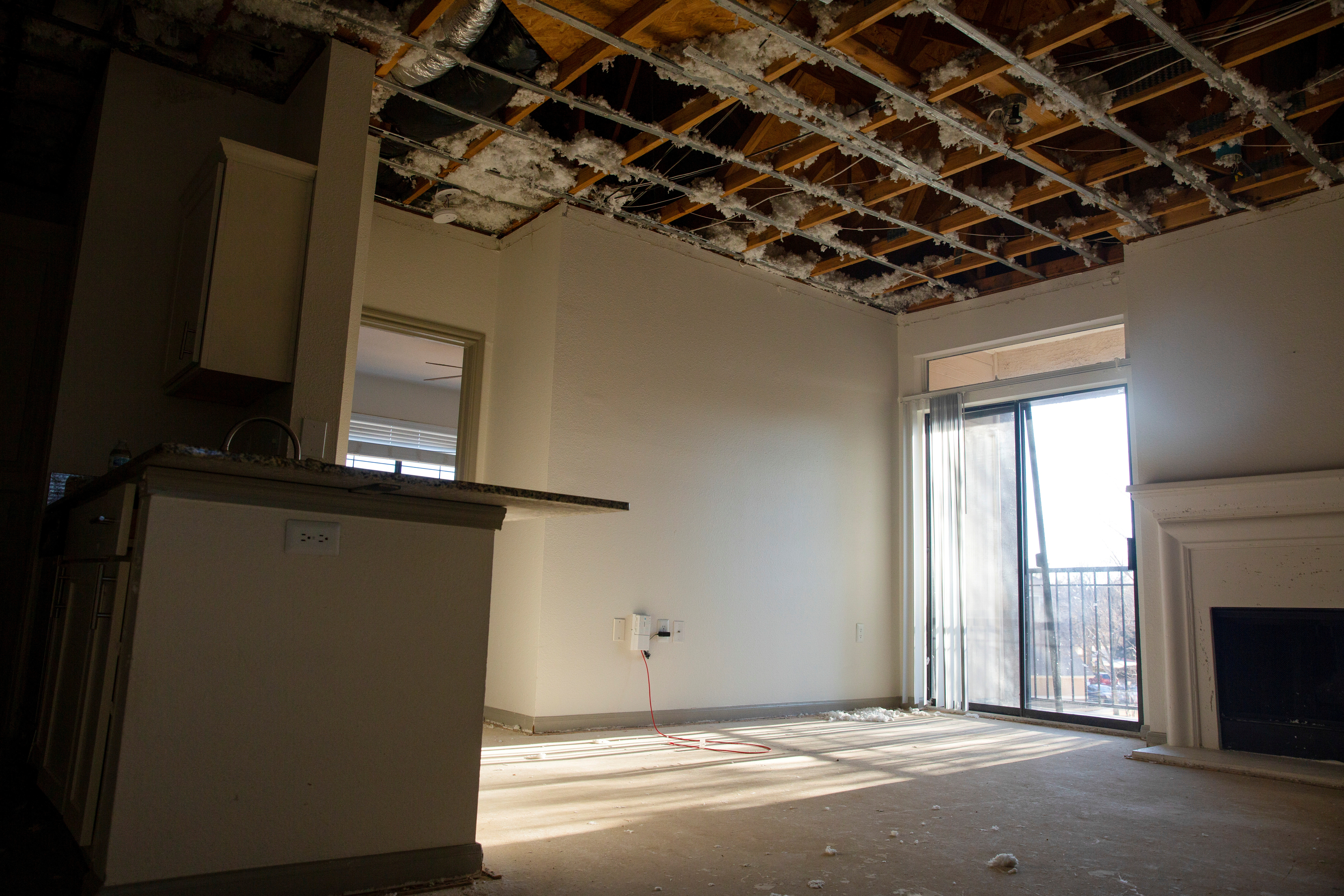 A damaged and exposed ceiling is seen in the unit above Melissa Wilson's apartment due to flooding from a burst pipe caused by winter weather in Fort Worth, Texas, U.S. February 24, 2021.  REUTERS/Shelby Tauber/File Photo