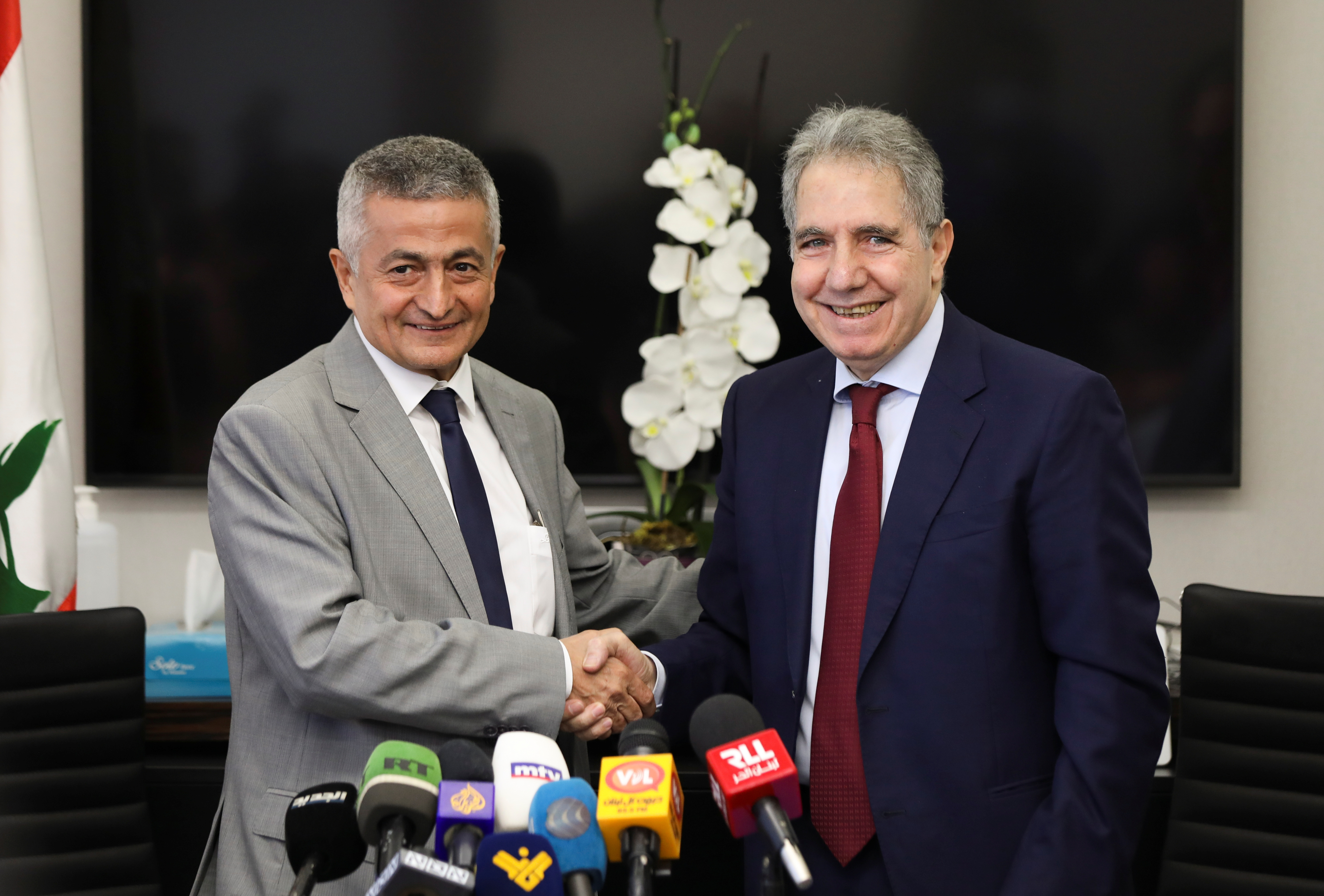 Lebanon's outgoing Finance Minister Ghazi Wazni shakes hands with the newly appointed Finance Minister Youssef Khalil during a handover ceremony in Beirut, Lebanon September 14, 2021. REUTERS/Mohamed Azakir