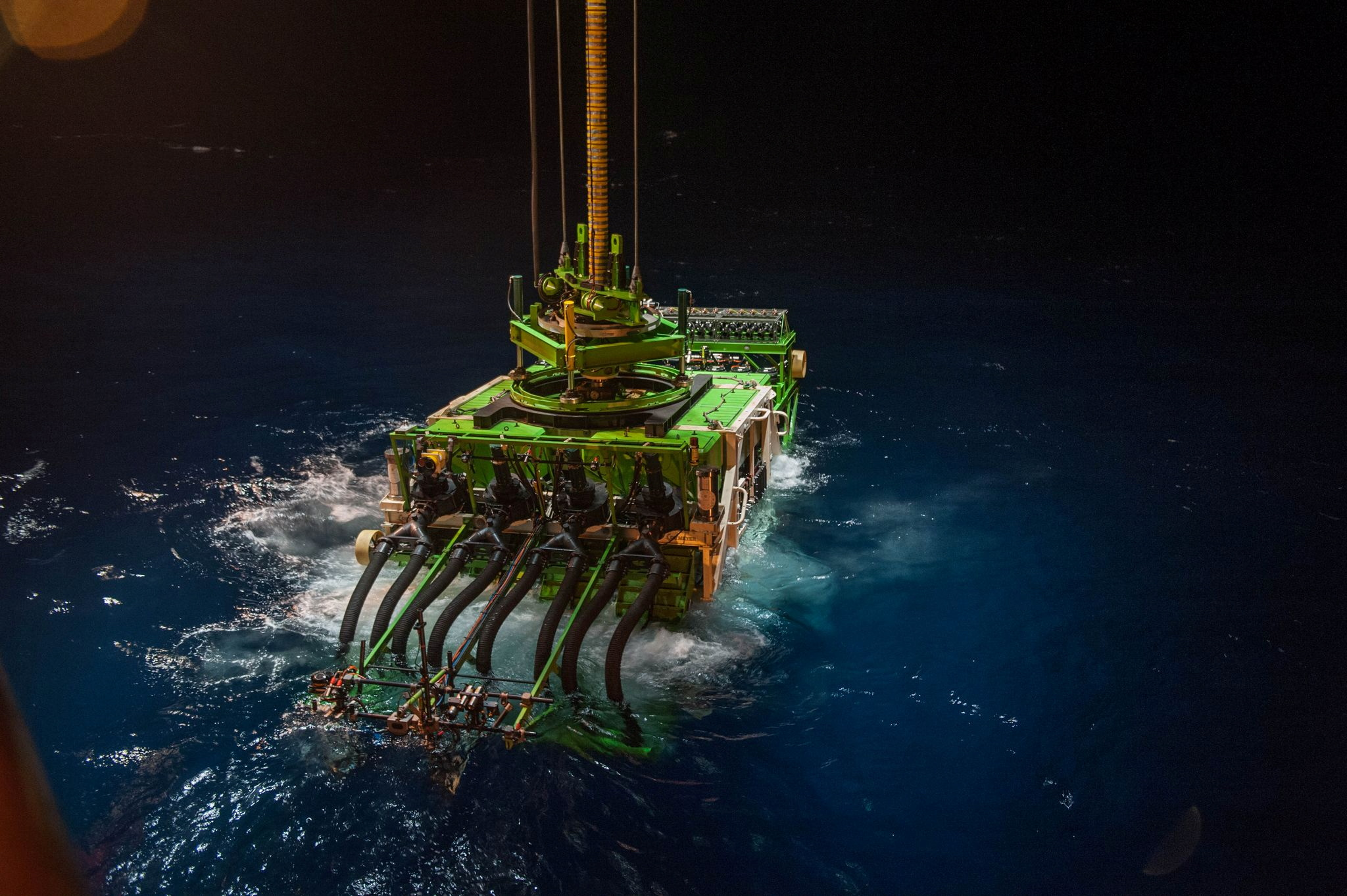 Patania II, a 25-tonne seabed mining robot, is lowered into the Pacific Ocean to begin a descent to the sea floor, in the Clarion Clipperton Zone of the Pacific Ocean, April 2021. GSR/Handout via REUTERS