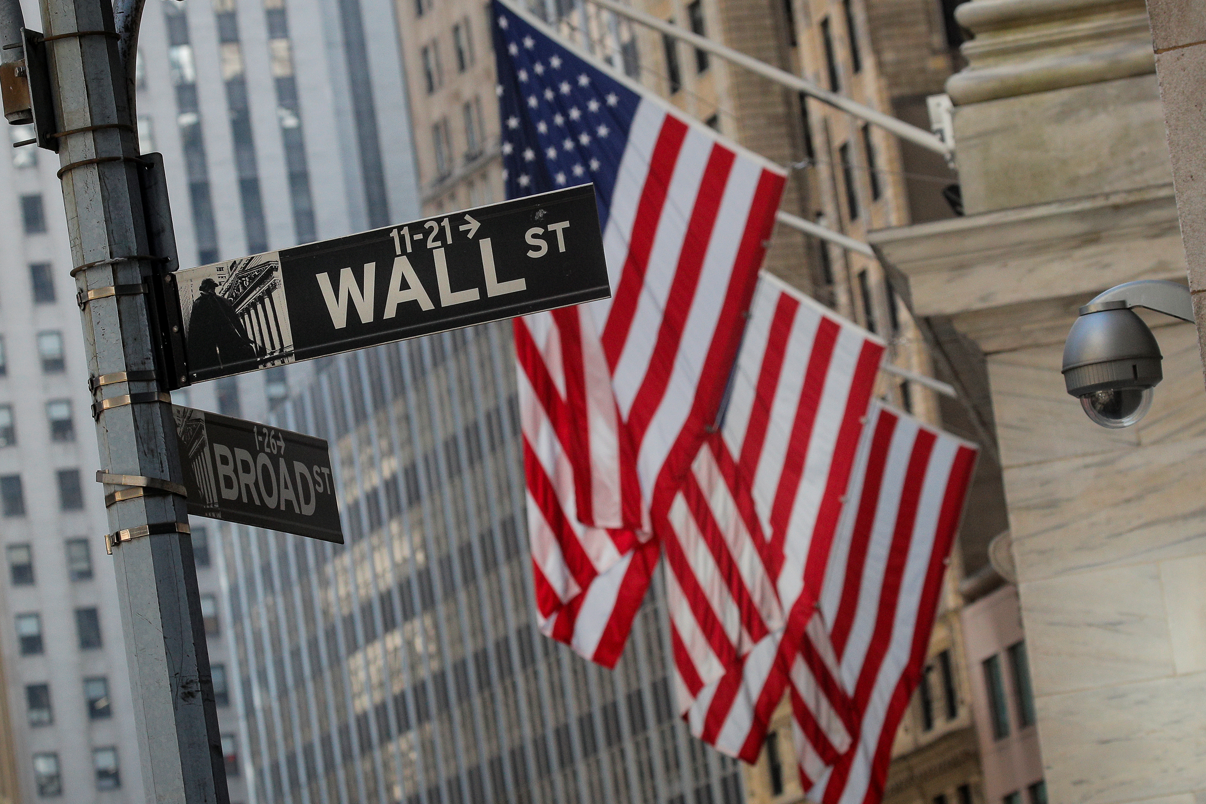 A Wall St. sign is seen outside the New York Stock Exchange (NYSE) in the financial district in New York City, U.S., March 2, 2020. REUTERS/Brendan McDermid