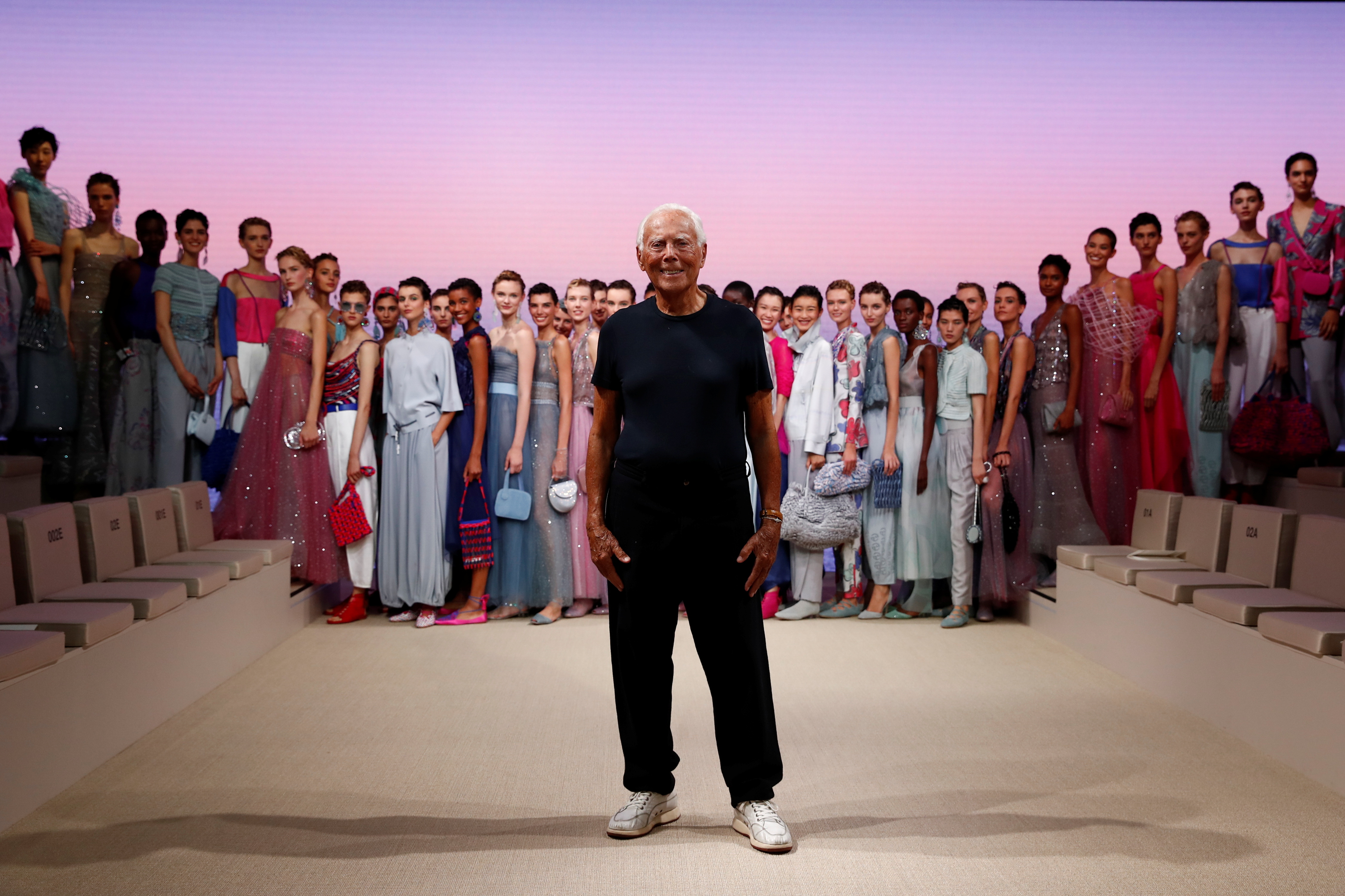 Designer Giorgio Armani appears with models at the end of the Giorgio Armani Spring/Summer 2022 collection during Milan Fashion Week in Milan, Italy, September 25, 2021. REUTERS/Alessandro Garofalo