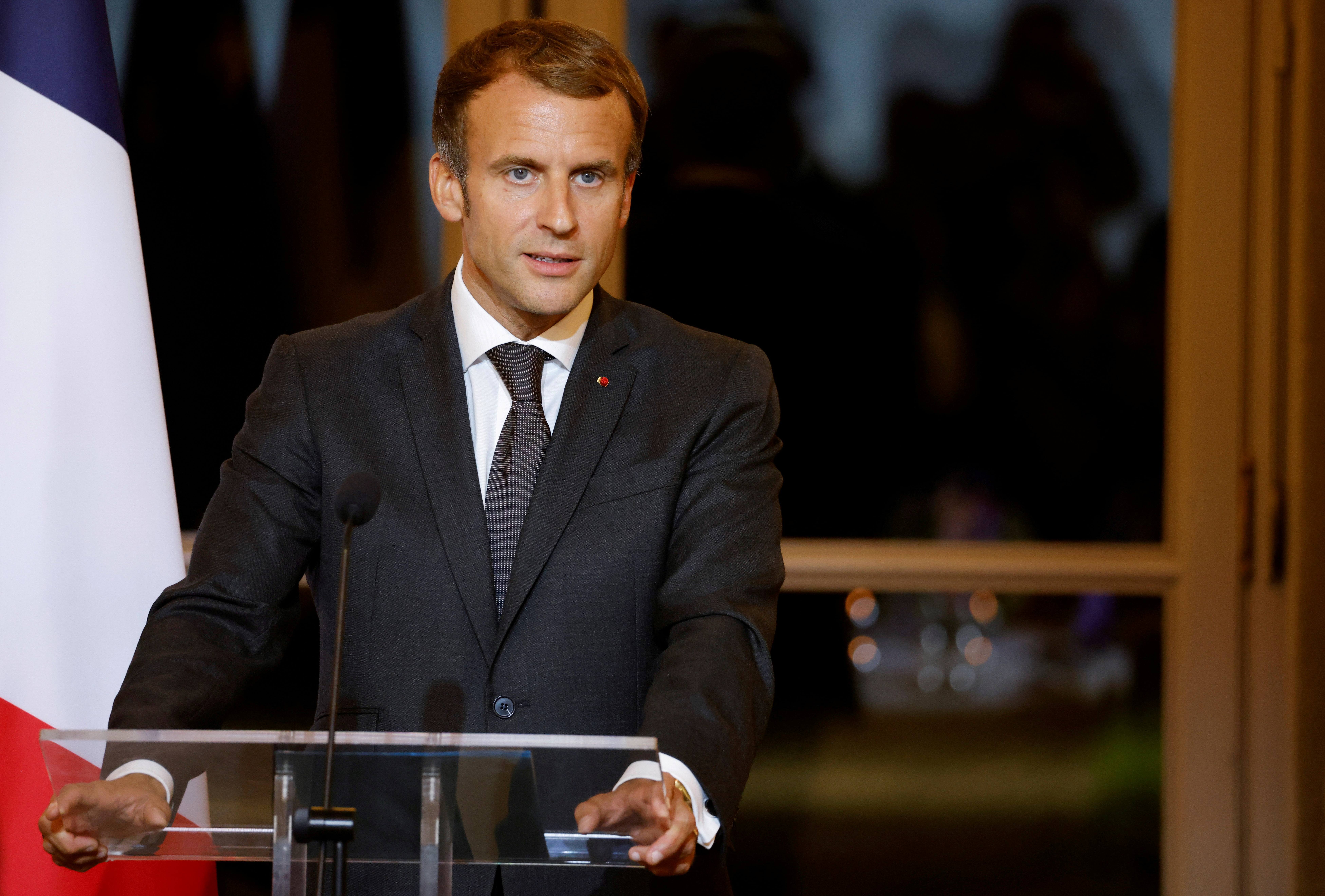 French President Emmanuel Macron delivers a speech as he hosts a dinner at the Elysee Palace as part of the closing ceremony of The Africa2020 Season, in Paris, France September 30, 2021.  Ludovic Marin/Pool via REUTERS