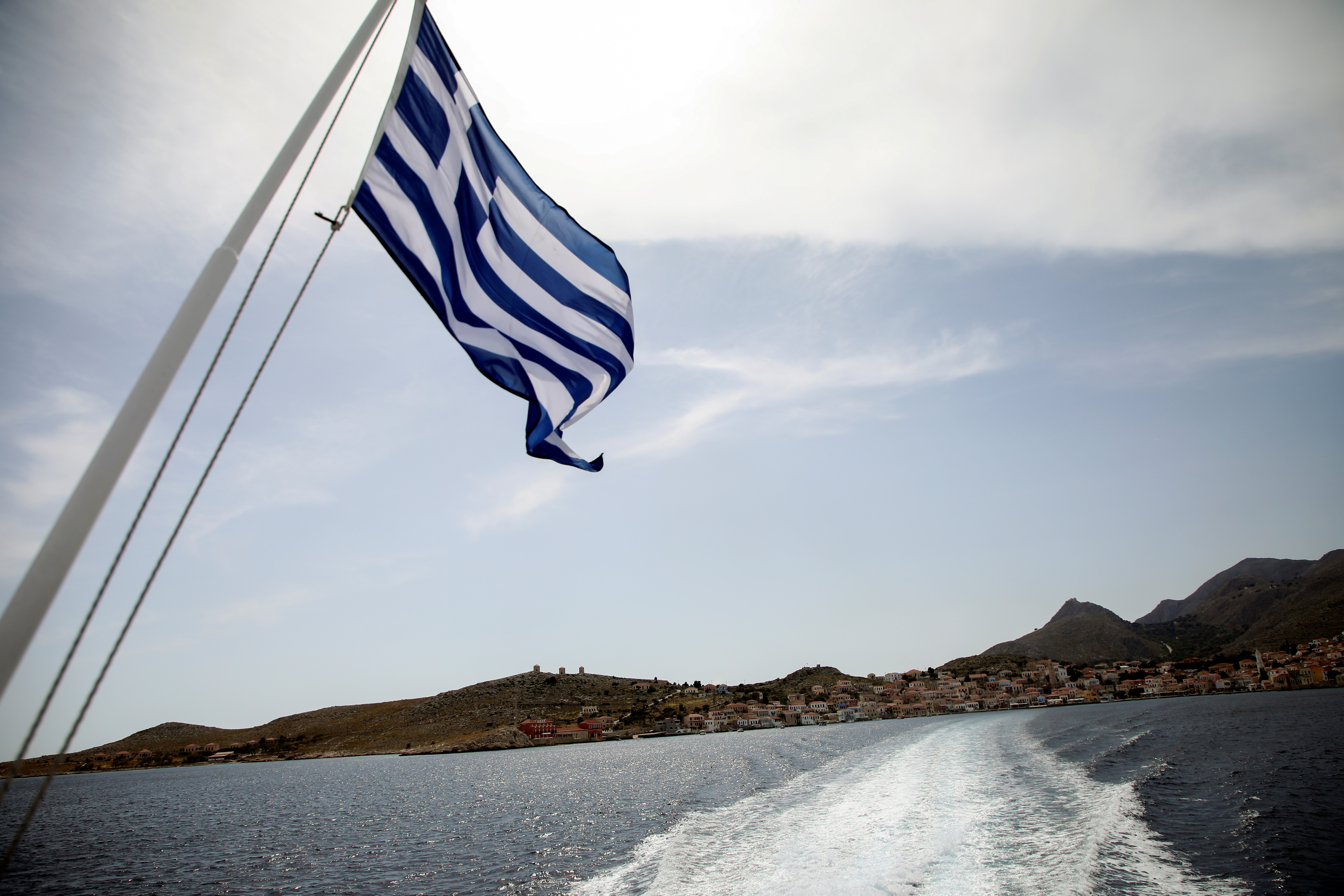 View of the island of Halki from a ferry sailing to the island of Rhodes, amid the coronavirus disease (COVID-19) pandemic, off the island of Halki, Greece, April 13, 2021. Picture taken April 13, 2021. REUTERS/Louiza Vradi/File Photo