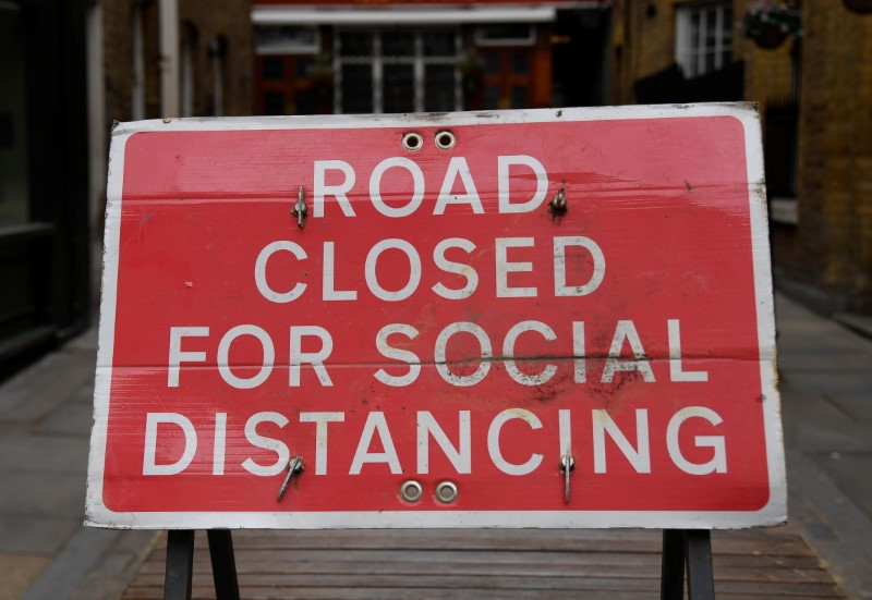 A sign is seen on a road in Covent Garden ahead of a further easing of lockdown restrictions for England on April 12, amid the spread of the coronavirus disease (COVID-19) pandemic, in London, Britain, April 6, 2021. REUTERS/Toby Melville