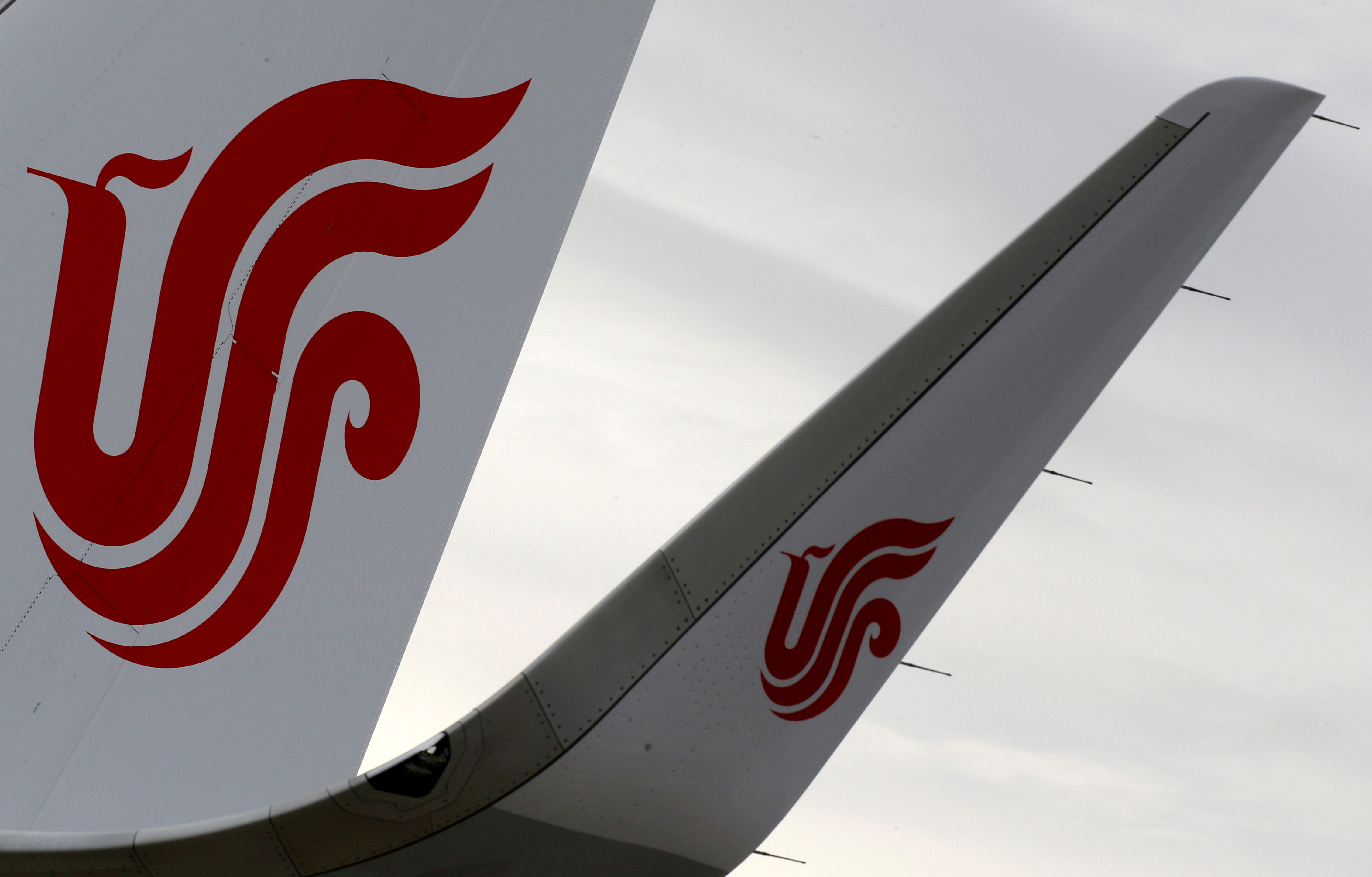 The logo of Air China is pictured on a tail of an airplane parked at the aircraft builder's headquarters of Airbus in Colomiers near Toulouse, France, November 15, 2019. REUTERS/Regis Duvignau