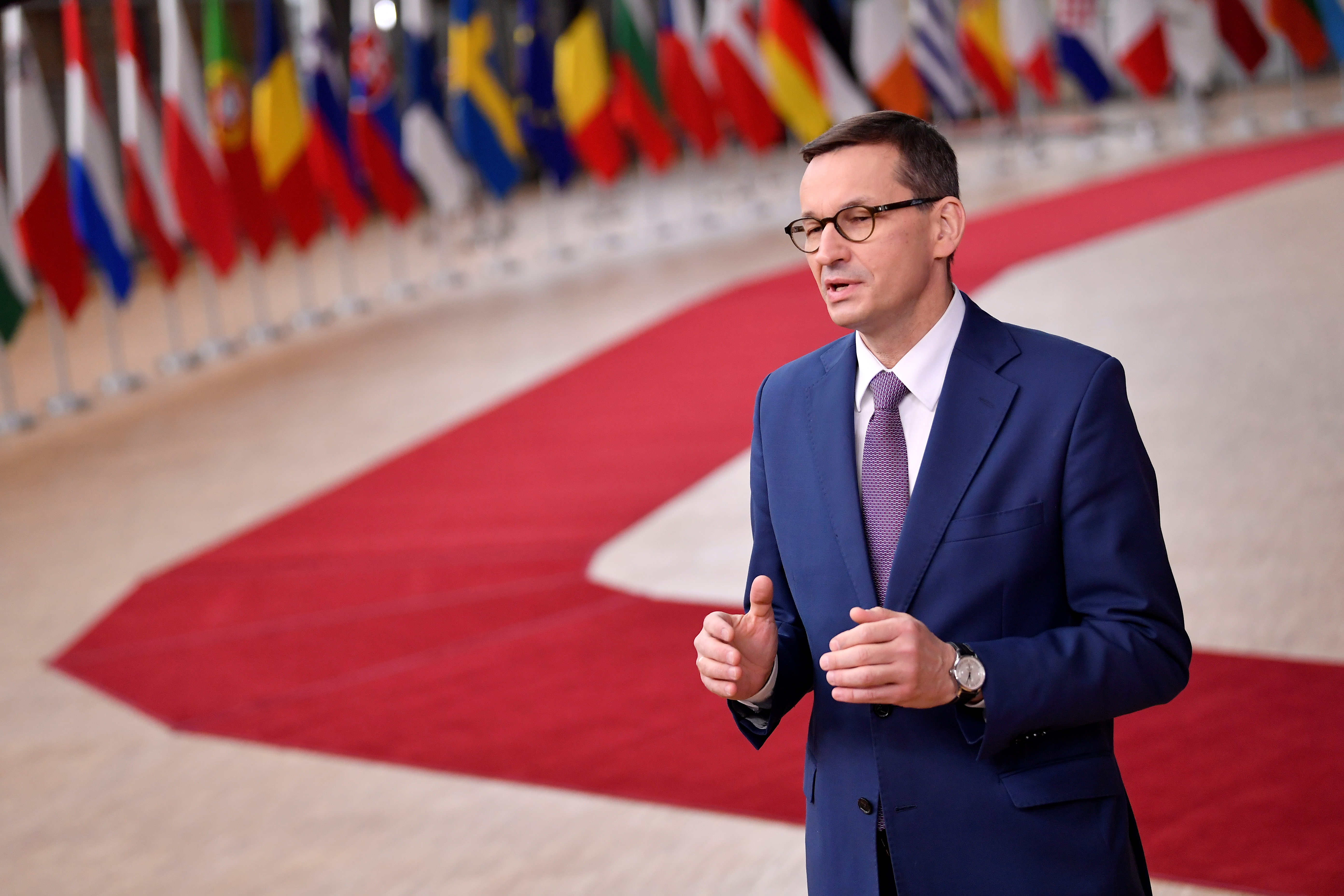 Poland's Prime Minister Mateusz Morawiecki speaks as he arrives to attend a face-to-face EU summit amid the coronavirus disease (COVID-19) lockdown in Brussels, Belgium December 10, 2020. John Thys/Pool via REUTERS/File Photo