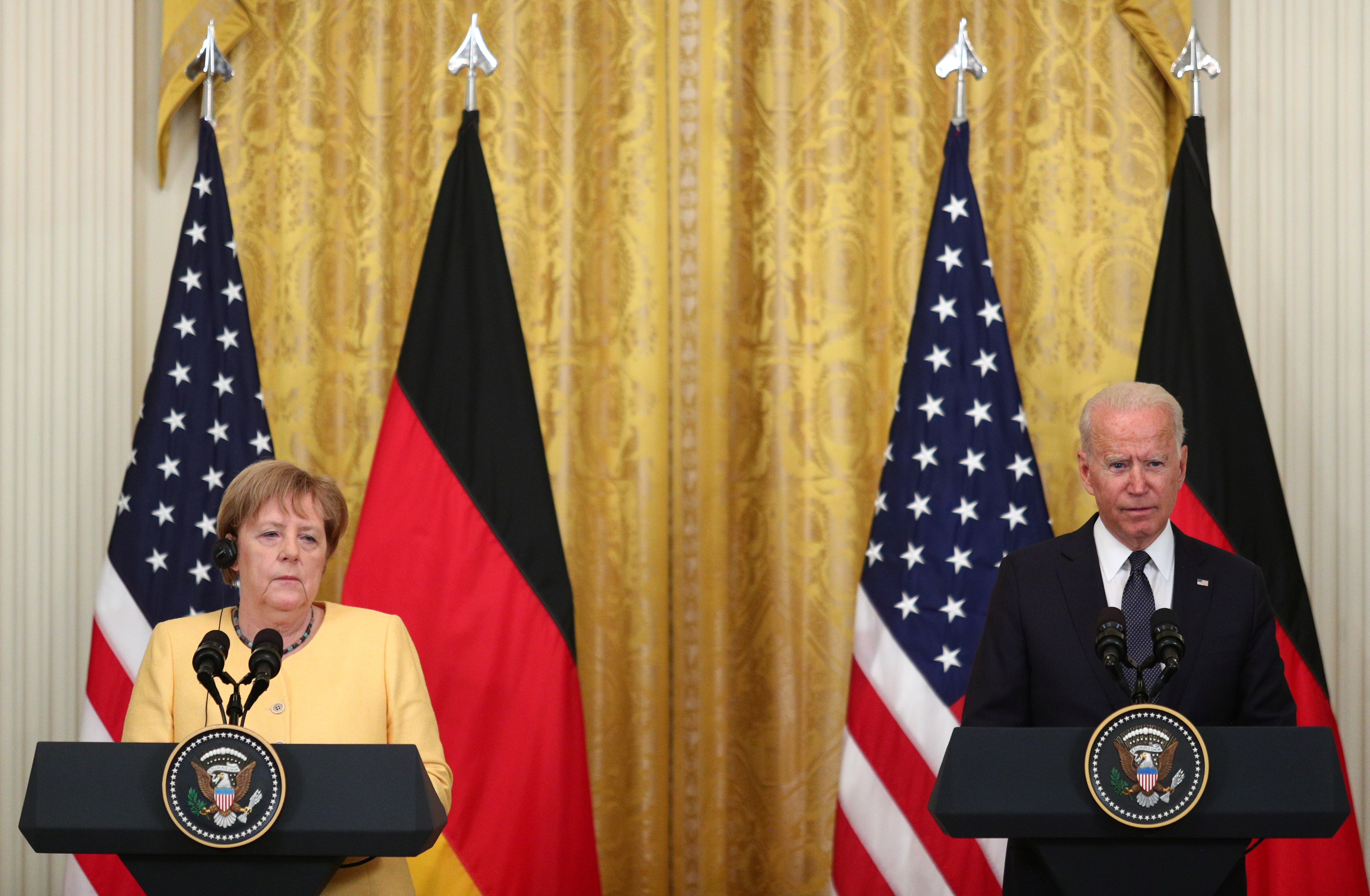 U.S. President Joe Biden and German Chancellor Angela Merkel attend a joint news conference in the East Room at the White House in Washington, U.S., July 15, 2021. REUTERS/Tom Brenner