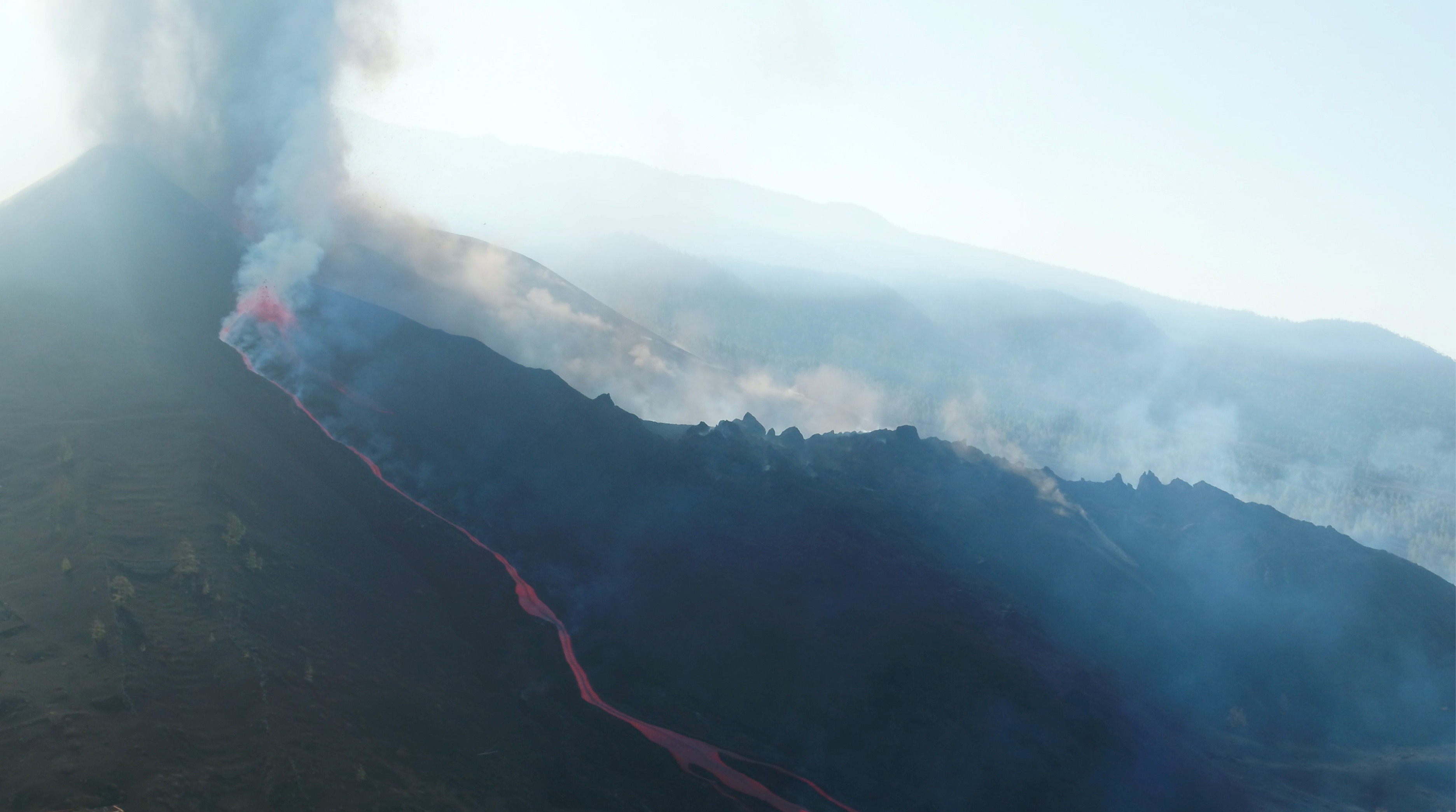 A screengrab from a drone footage shows lava flowing following the eruption of a volcano in the Cumbre Vieja park, on the Canary Island of La Palma, Spain September 26, 2021.   REUTERS TV via REUTERS