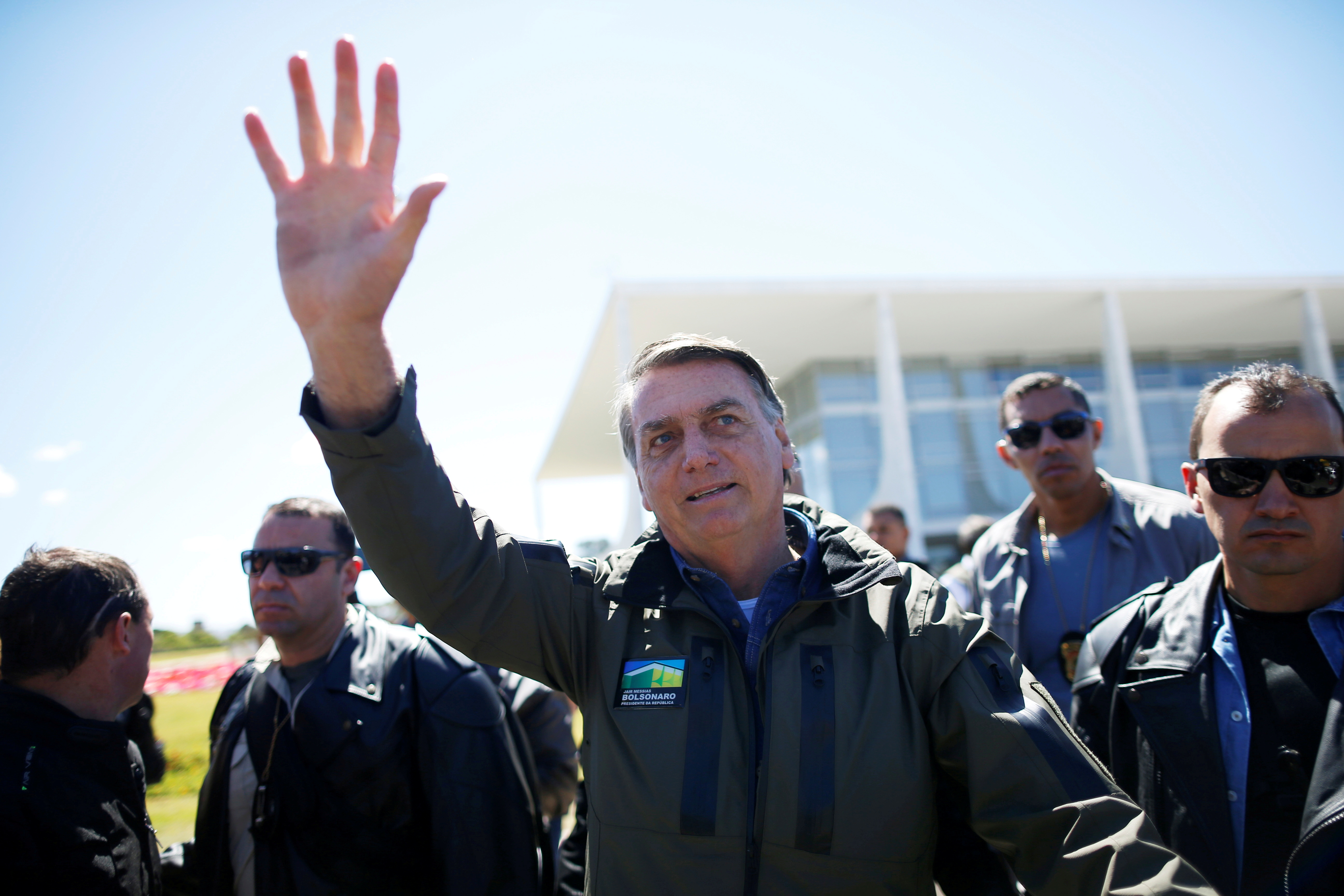 Brazil's President Jair Bolsonaro gestures after a ride on a motorbike in a motorcade rally with his supporters amid the coronavirus disease (COVID-19) pandemic, in Brasilia, Brazil, August 8, 2021. REUTERS/Adriano Machado/File Photo
