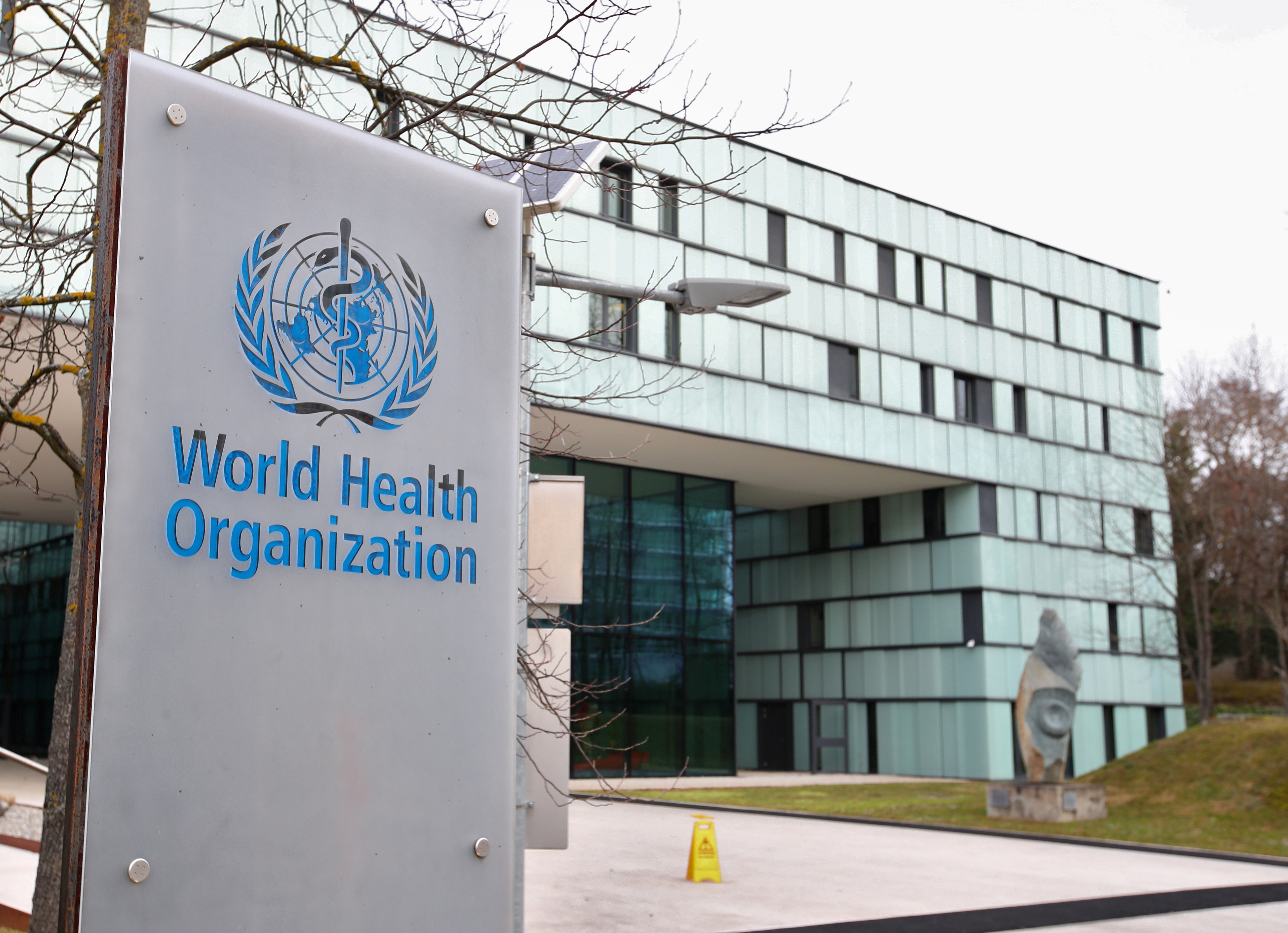 A logo is pictured outside a building of the  World Health Organization (WHO) during an executive board meeting on update on the coronavirus outbreak, in Geneva, Switzerland, February 6, 2020. REUTERS/Denis Balibouse/File Photo