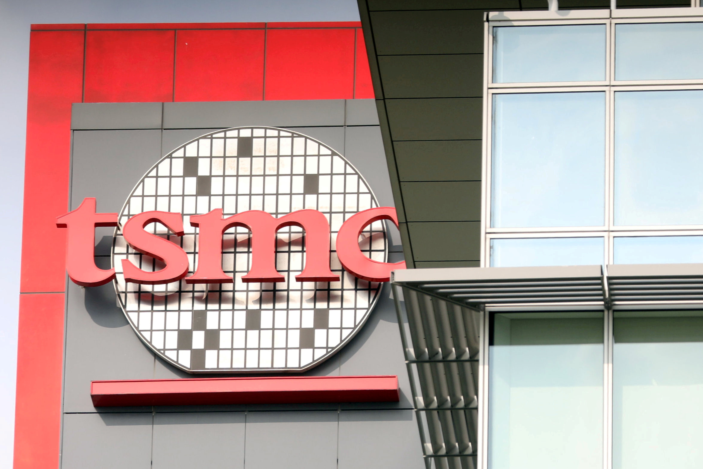 The logo of Taiwan Semiconductor Manufacturing Co (TSMC) is seen on one of its office buildings in Tainan, Taiwan August 20, 2020. REUTERS/Ann Wang