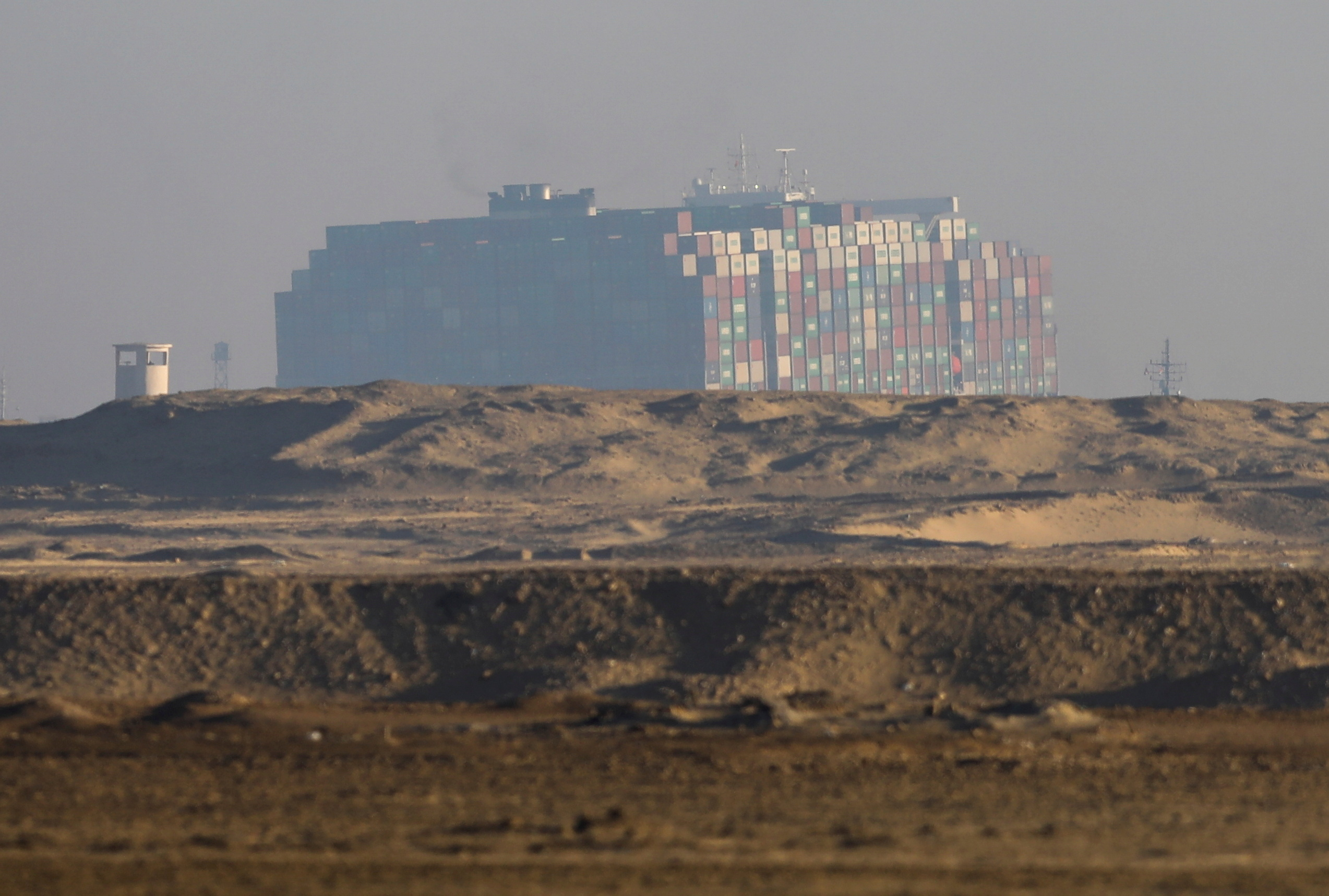 A view shows the container ship Ever Given, one of the world's largest container ships, in Suez Canal, Egypt March 29, 2021. REUTERS/Mohamed Abd El Ghany