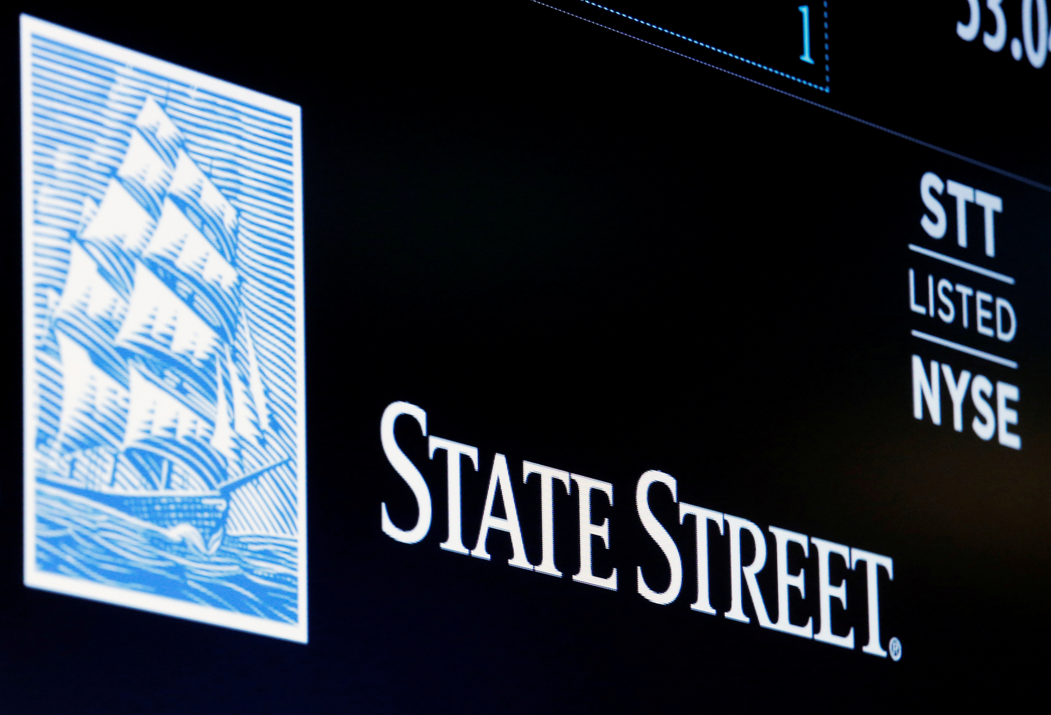 The ticker and logo for State Street Corporation is displayed on a screen at the post where it's traded on the floor of the New York Stock Exchange (NYSE) in New York City, U.S., June 30, 2016.  REUTERS/Brendan McDermid/File Photo