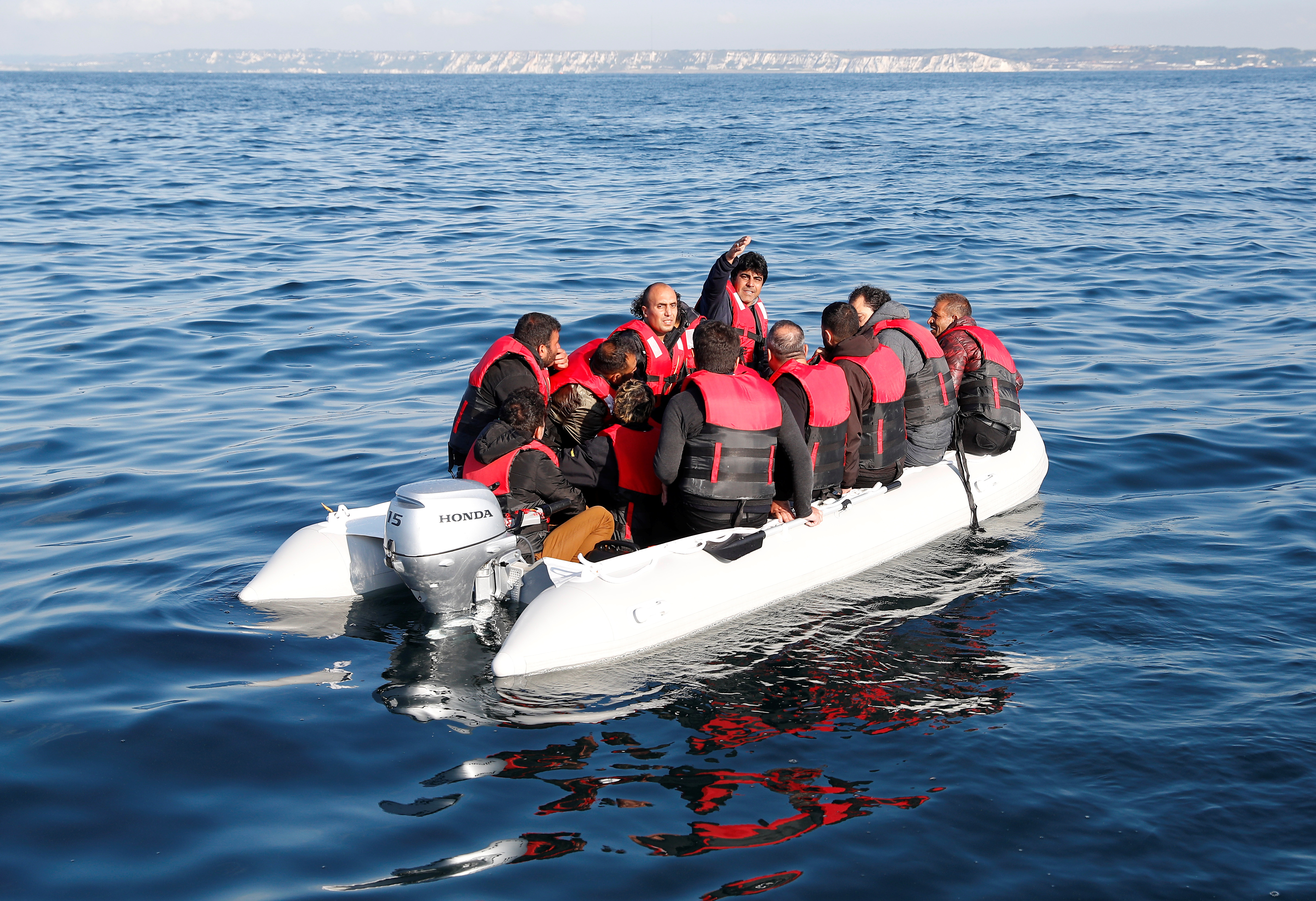 Migrants who launched from the coast of northern France cross the English Channel in an inflatable boat near Dover, Britain, August 4, 2021. Picture taken August 4, 2021.  REUTERS/Peter Nicholls