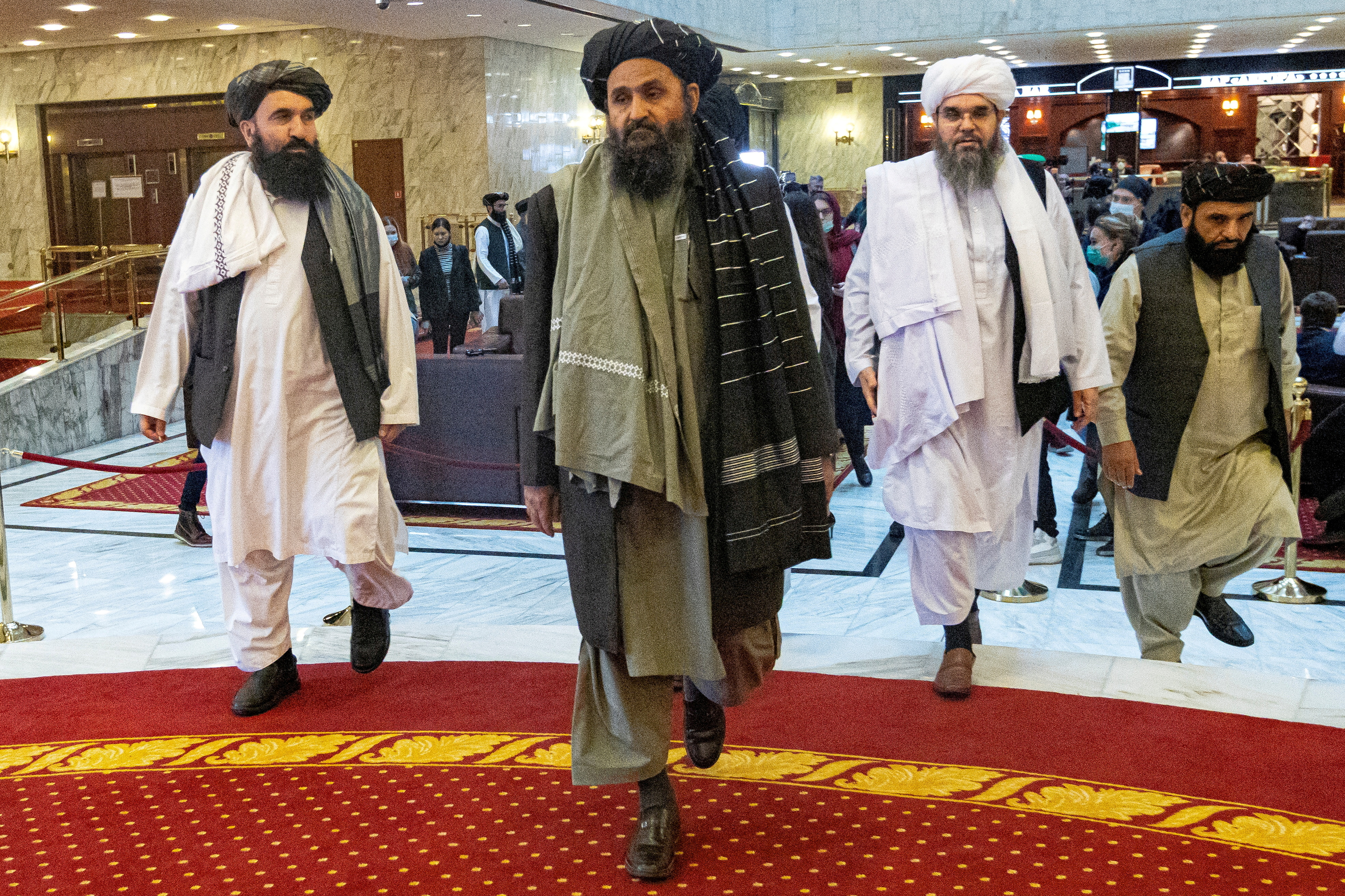 Mullah Abdul Ghani Baradar, the Taliban's deputy leader and negotiator, and other delegation members attend the Afghan peace conference in Moscow, Russia March 18, 2021. Alexander Zemlianichenko/Pool via REUTERS