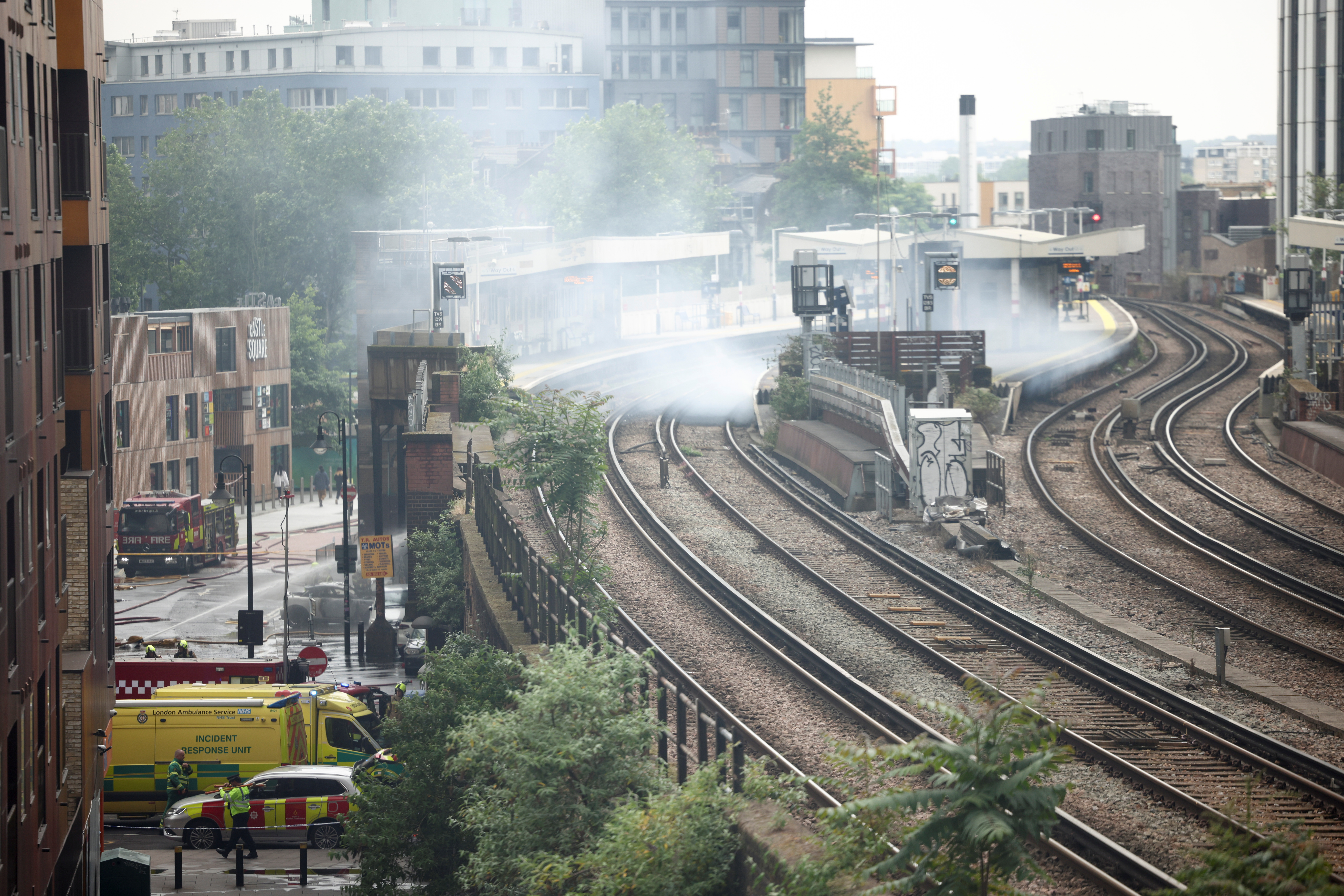 Emergency crews attend to a scene of fire at the Elephant and Castle train station in London, Britain June 28, 2021. REUTERS/Henry Nicholls