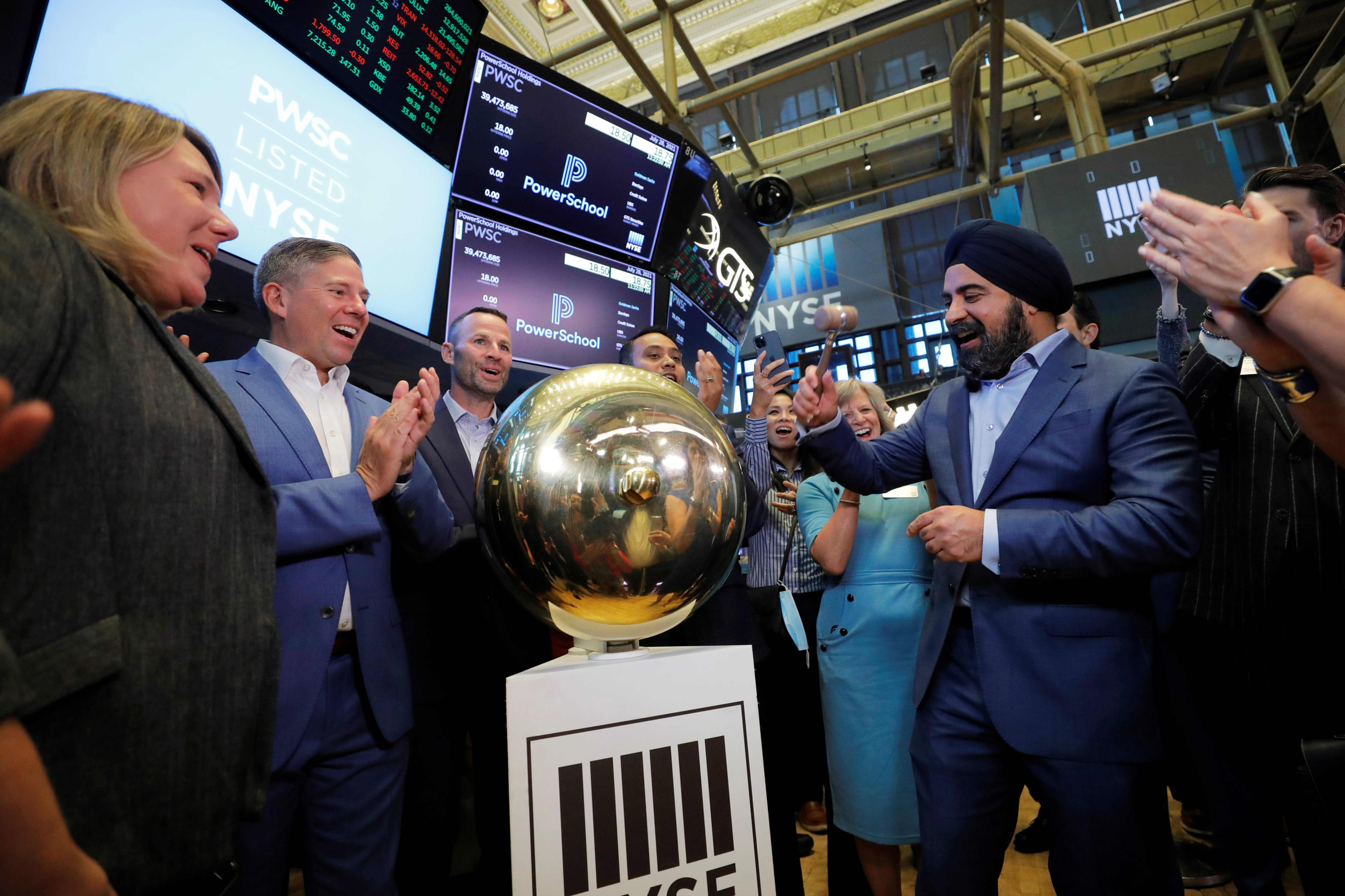 PowerSchool CEO Hardeep Gulati rings a ceremonial bell during their Initial public offering (IPO) the New York Stock Exchange (NYSE) in New York City, New York, U.S., July 28, 2021. REUTERS/Andrew Kelly