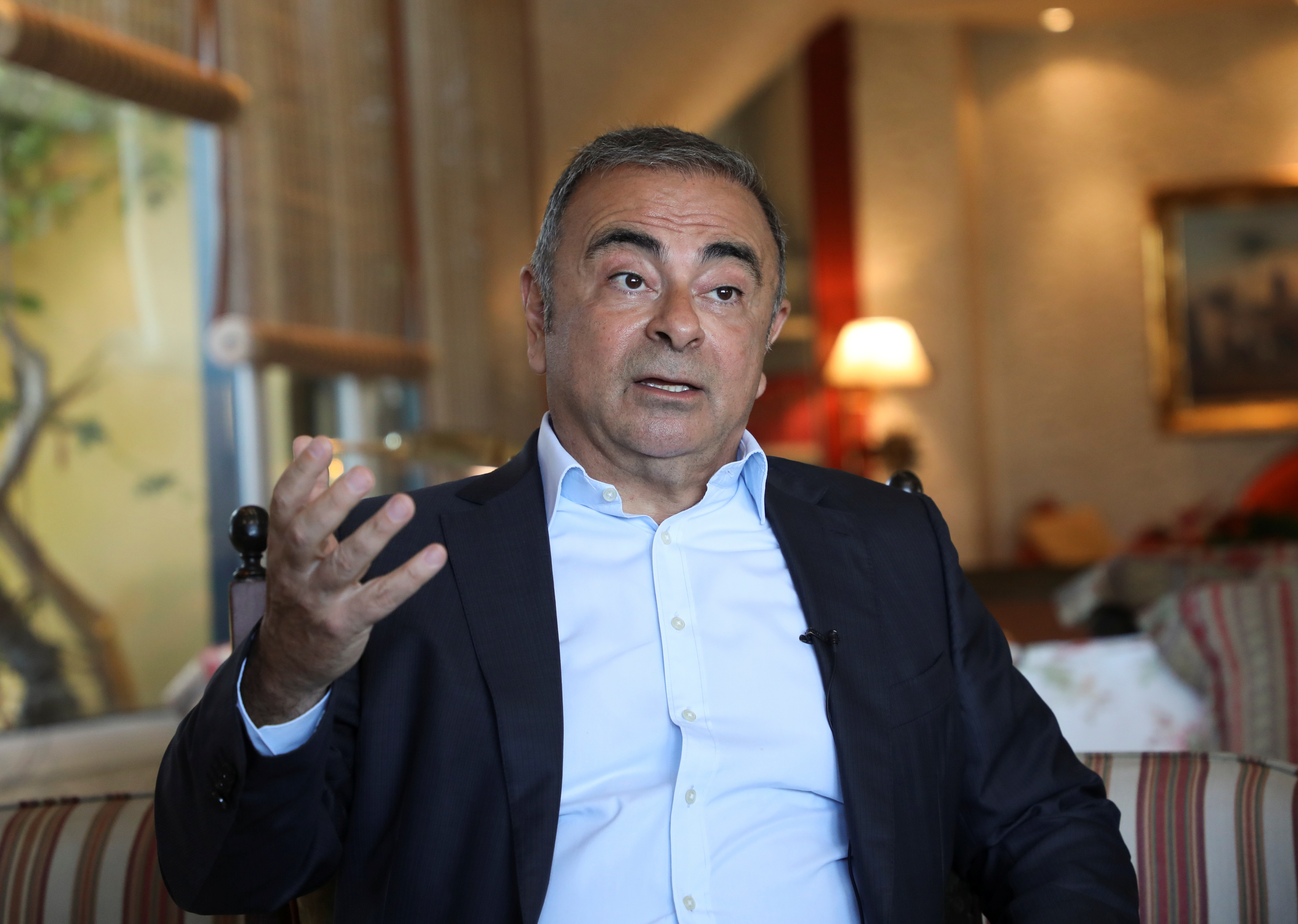 Former Nissan Chairman Carlos Ghosn talks during an interview with Reuters in Beirut, Lebanon June 14, 2021. REUTERS/Mohamed Azakir