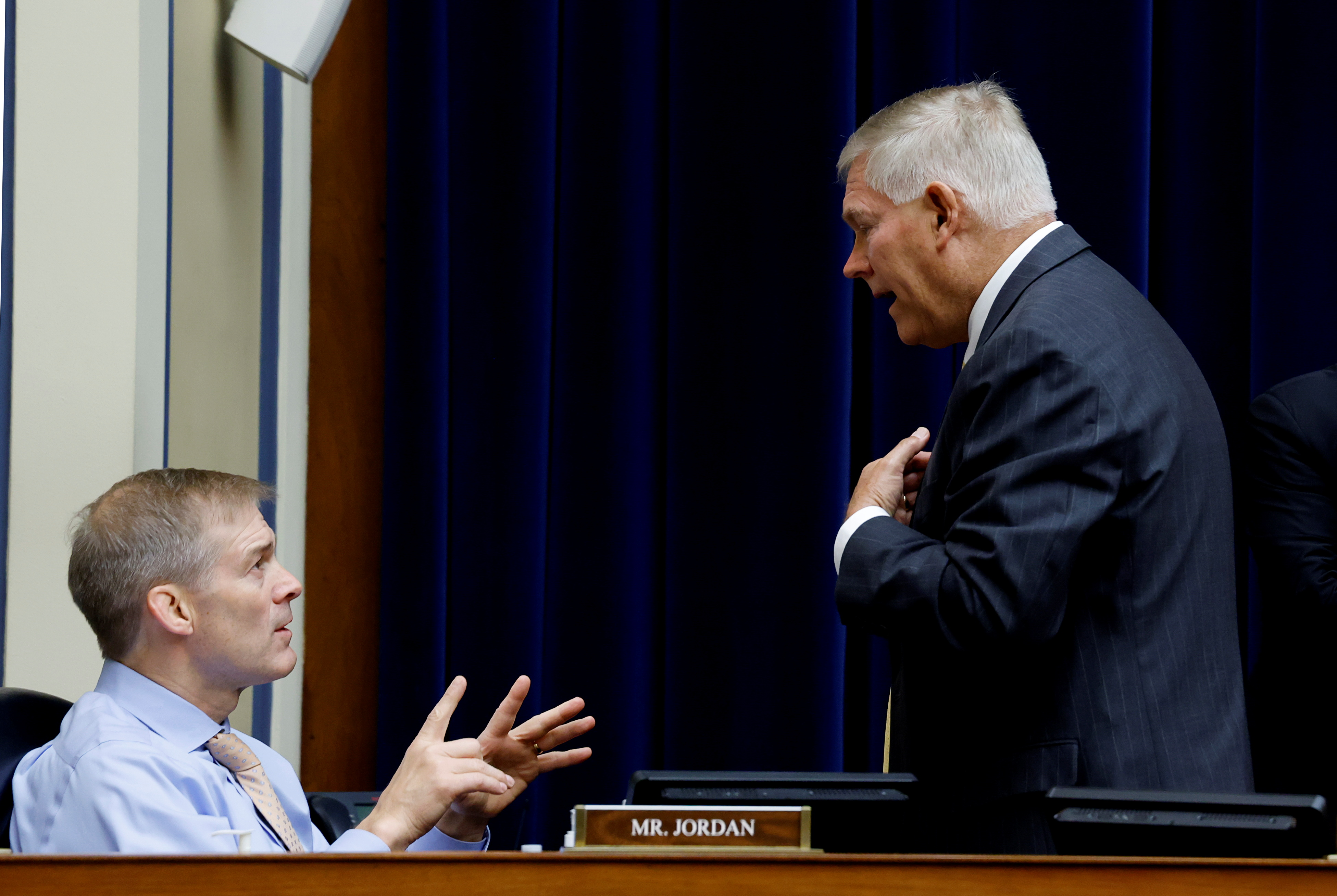 U.S. Rep. Jim Jordan (R-OH) speaks with Rep. Pete Sessions (R-TX) during a House Oversight and Reform Committee hearing titled ?The Capitol Insurrection: Unexplained Delays and Unanswered Questions,? regarding the on January 6 attack on the U.S. Capitol, on Capitol Hill in Washington, U..S., May 12, 2021 REUTERS/Jonathan Ernst/Pool