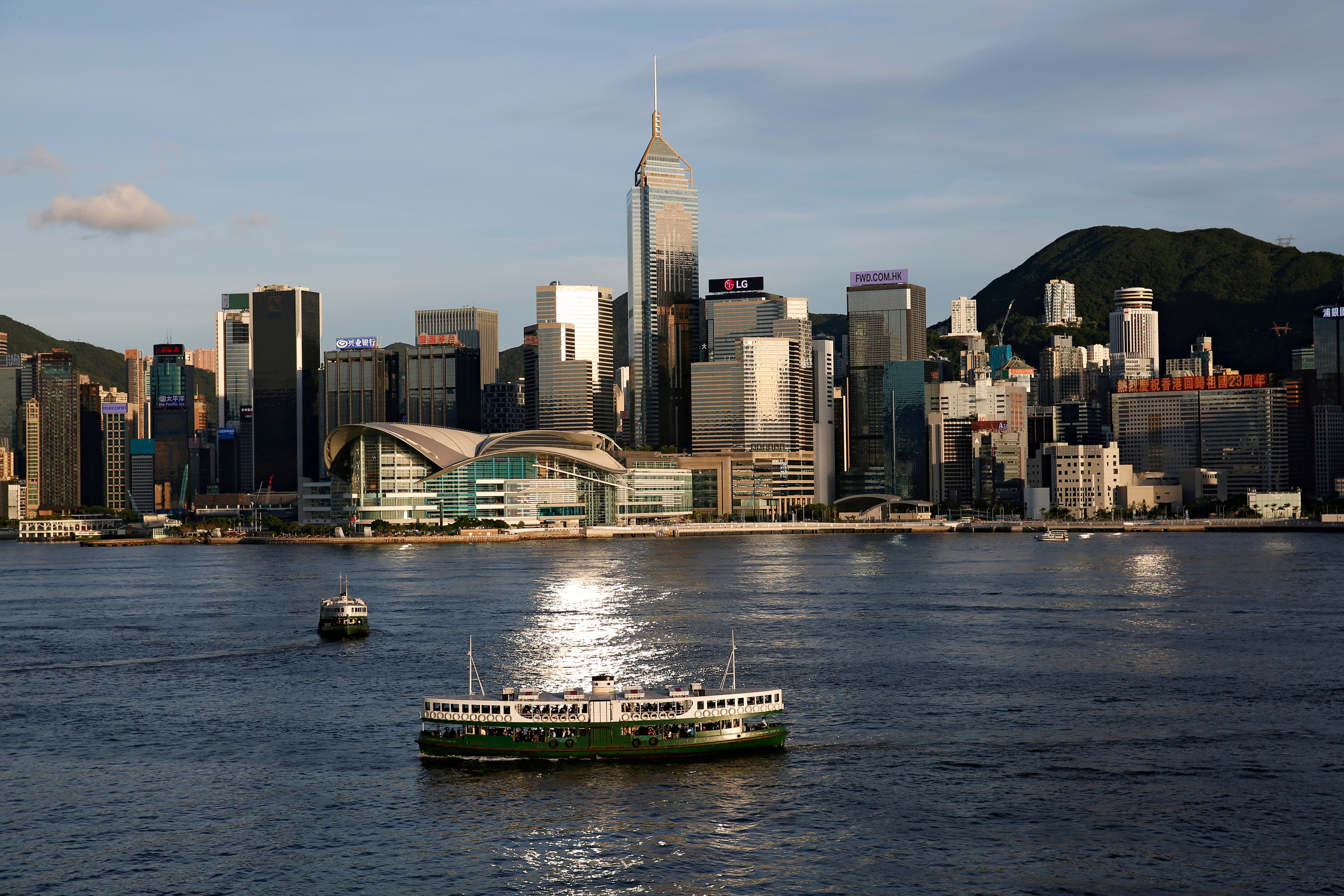 A Star Ferry boat crosses Victoria Harbour in front of a skyline of buildings in Hong Kong, China June 29, 2020. REUTERS/Tyrone Siu