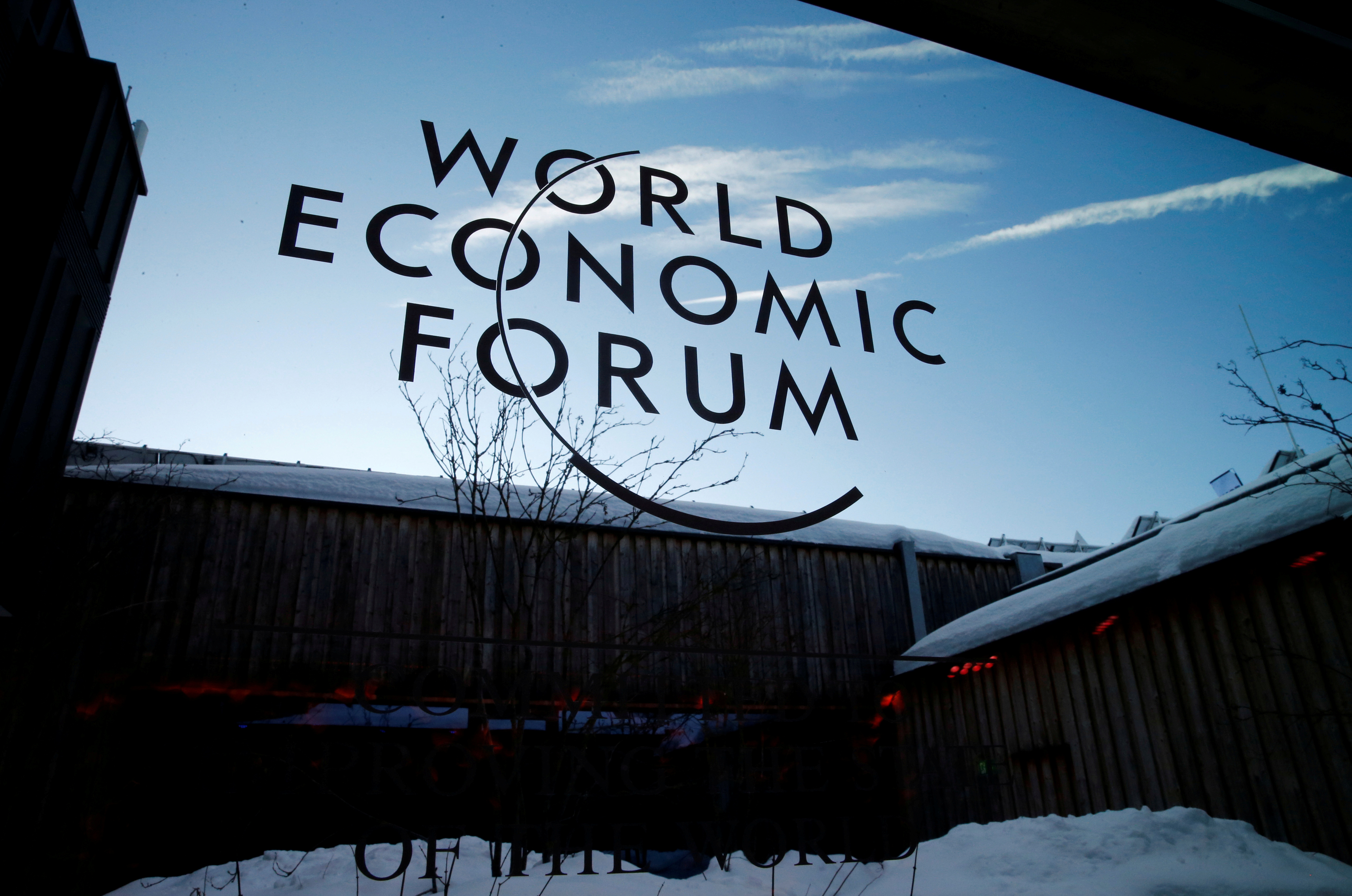 A logo of the 50th World Economic Forum (WEF) annual meeting is pictured on a window in Davos, Switzerland, January 21, 2020. REUTERS/Denis Balibouse/File Photo