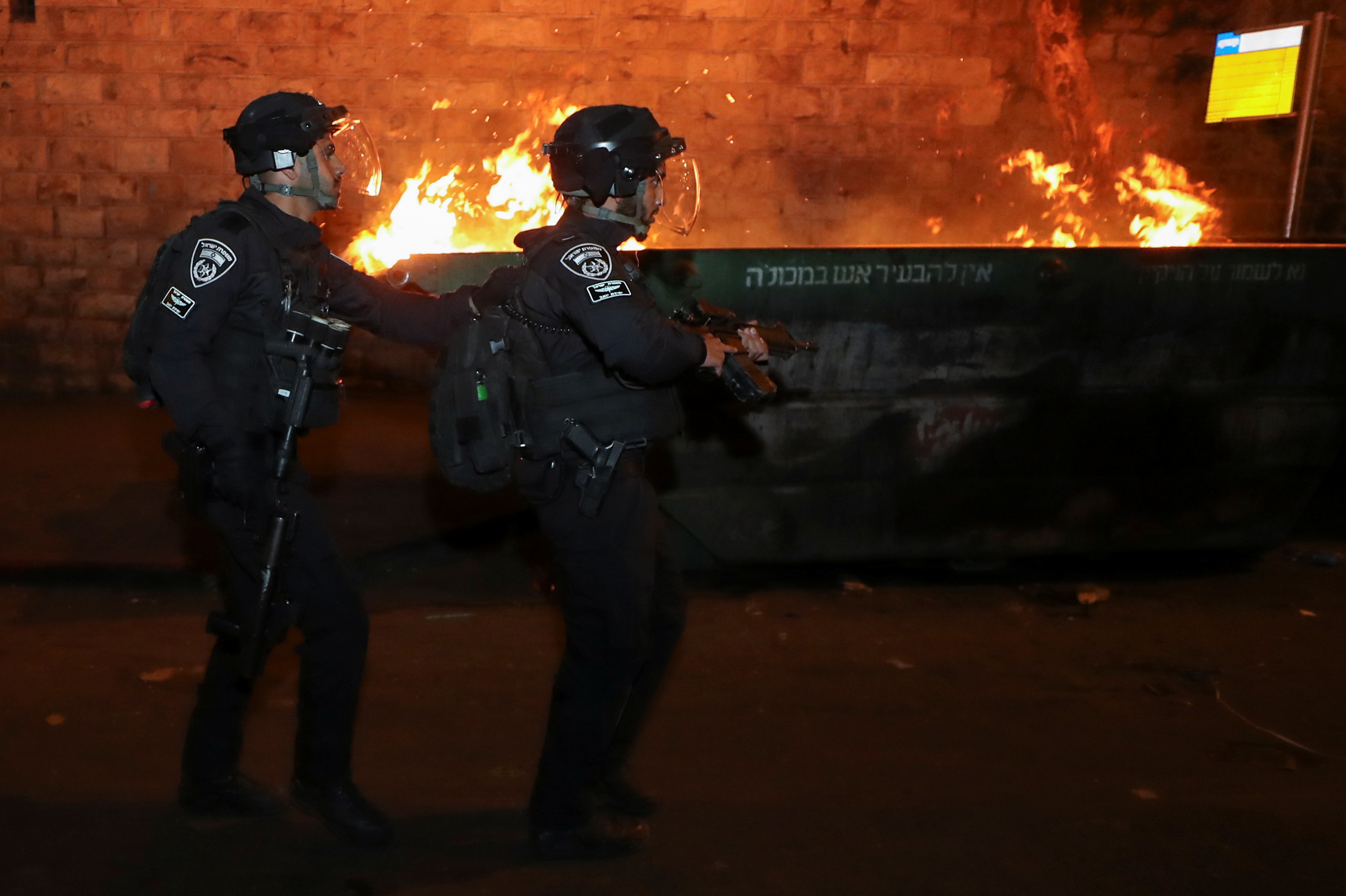 Israeli police officers walk during clashes with Palestinian protesters, as the Muslim holy fasting month of Ramadan continues, in Jerusalem, April 24, 2021. REUTERS/Ammar Awad