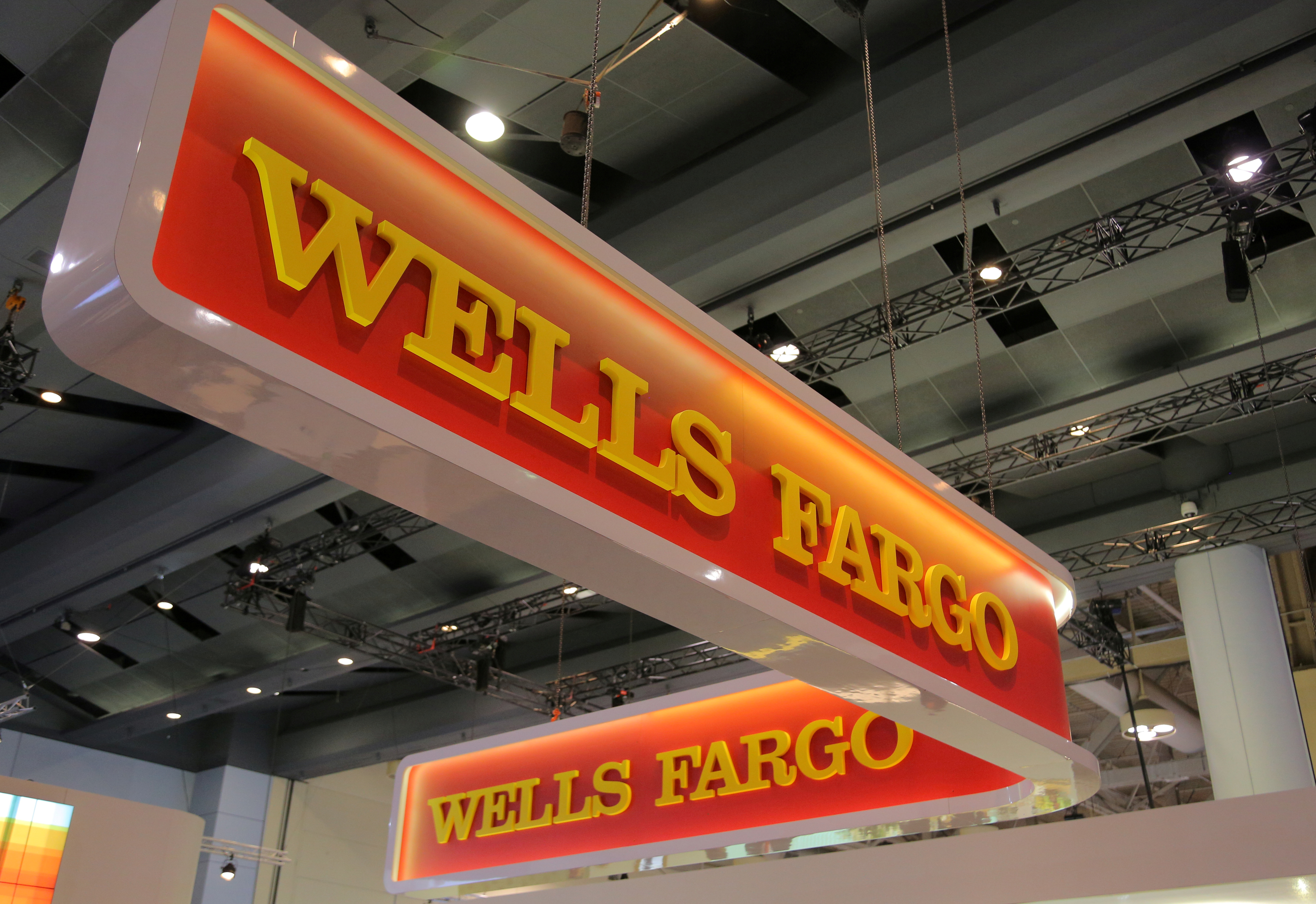 A Wells Fargo logo is seen at the SIBOS banking and financial conference in Toronto, Ontario, Canada October 19, 2017.  REUTERS/Chris Helgren