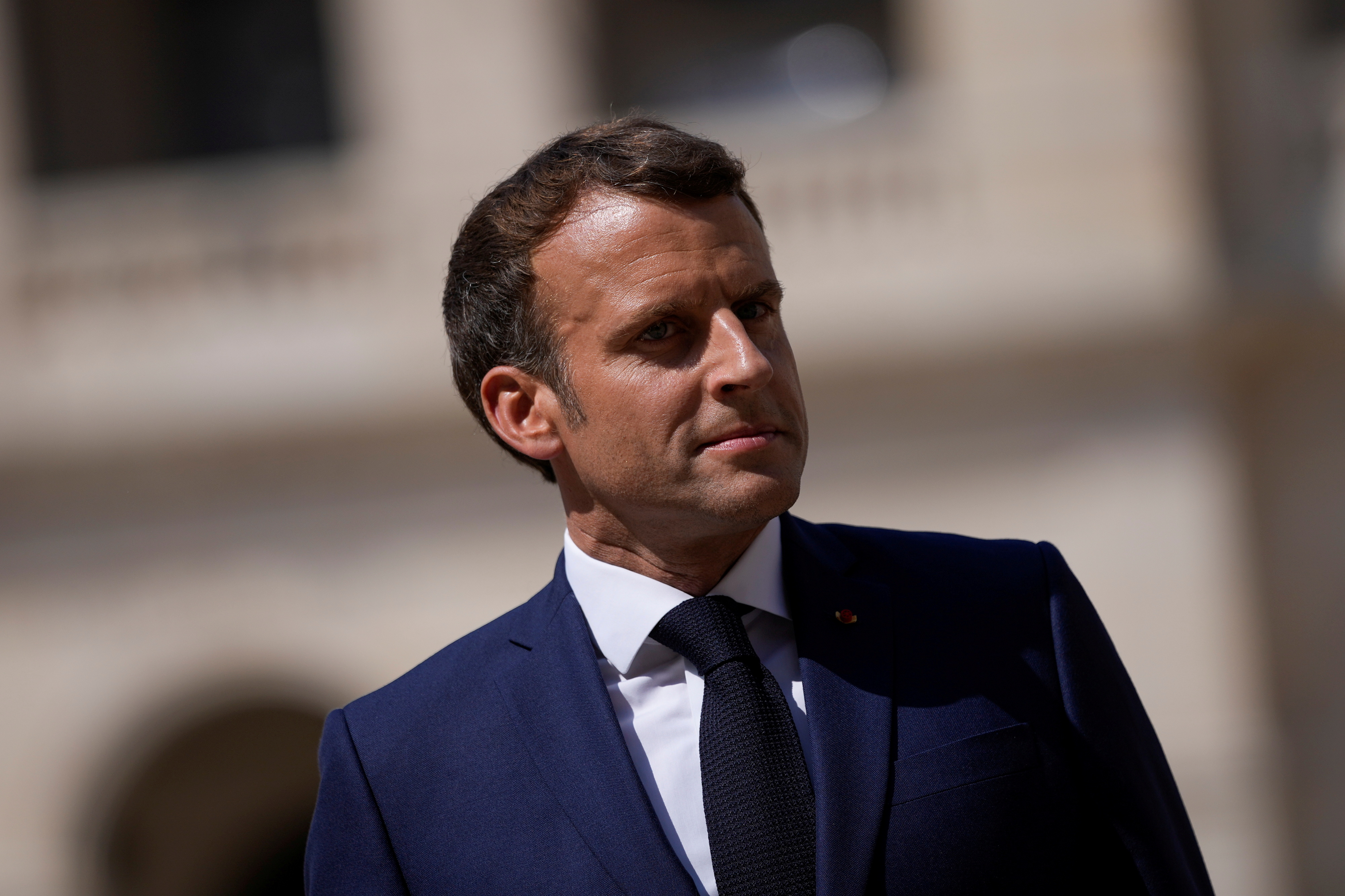 French President Emmanuel Macron attends a farewell ceremony for the French armed forces chief of staff, General Francois Lecointre at the Invalides monument in Paris, France July 21, 2021. Daniel Cole/Pool via REUTERS/File Photo