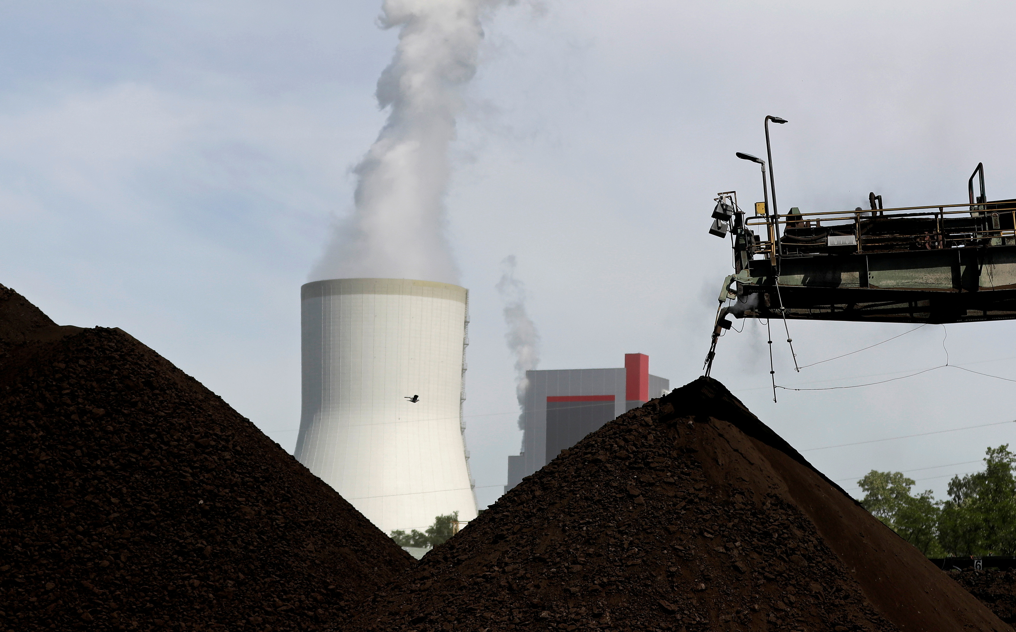 A cooling tower from the Turow coal-fired power plant is seen near the Turow open-pit coal mine operated by the company PGE in Bogatynia, Poland, June 15, 2021. REUTERS/David W Cerny