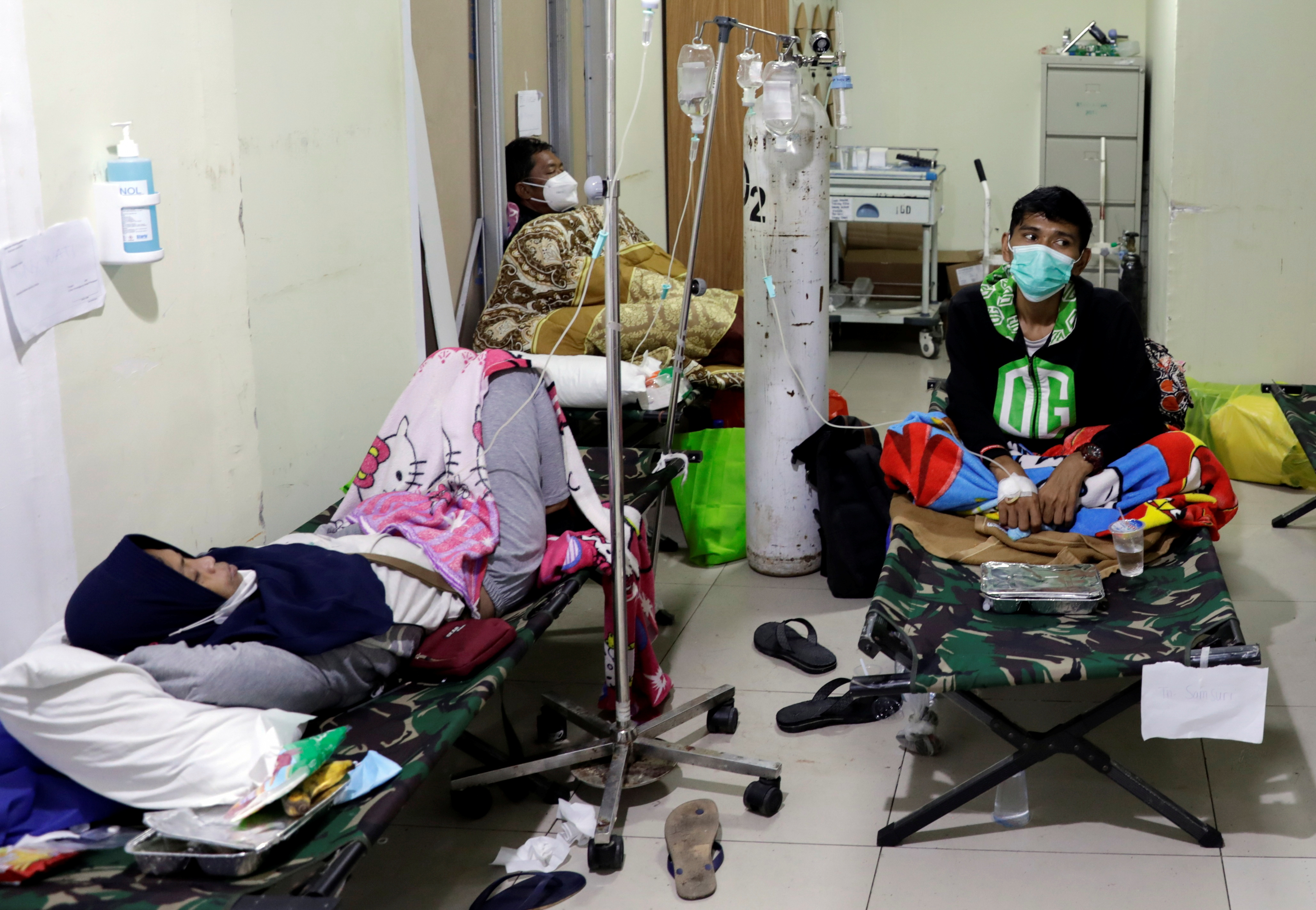 People rest on veld beds inside the emergency ward for the coronavirus disease (COVID-19) patients  at a government-run hospital in Jakarta, Indonesia, June 29, 2021. REUTERS/Willy Kurniawan