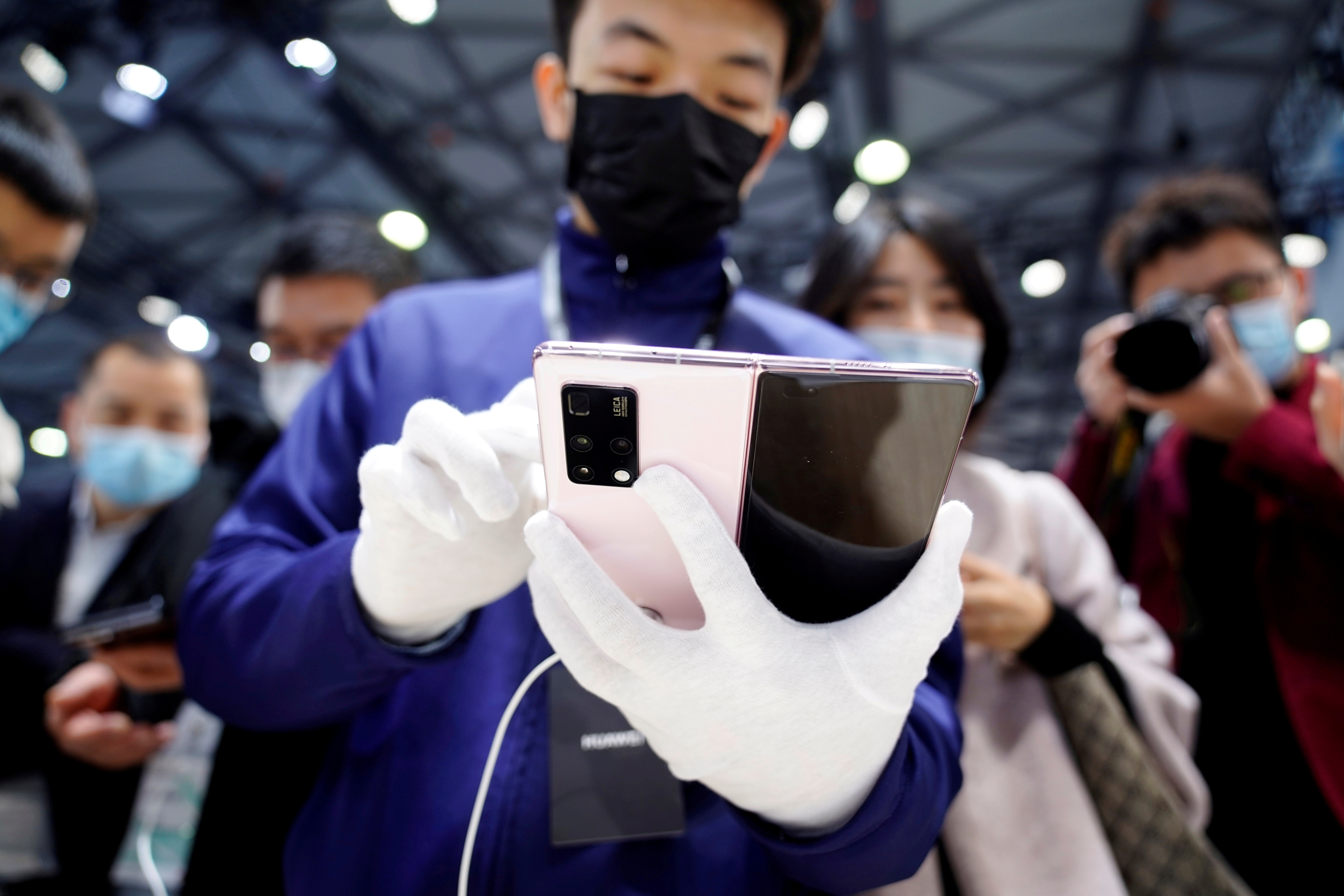 A staff member holds Huawei's new 5G Mate X2 foldable phone at the Mobile World Congress (MWC) in Shanghai, China February 23, 2021. REUTERS/Aly Song/File Photo