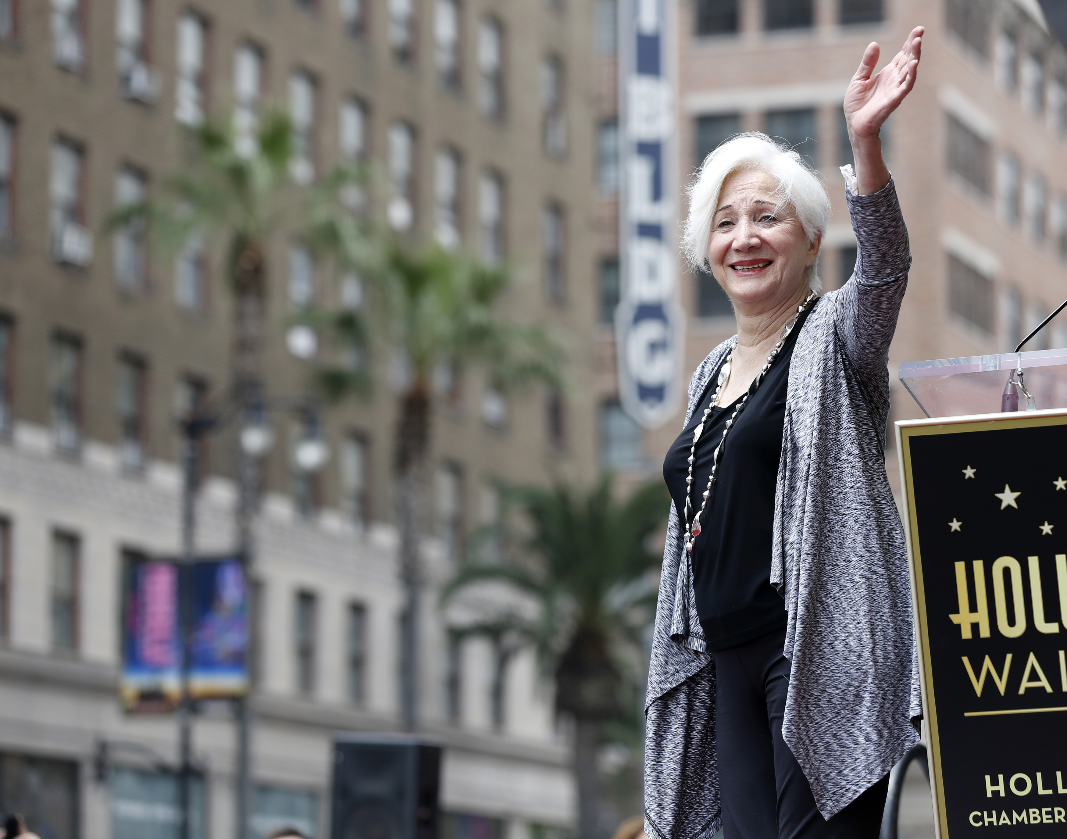 Actress Olympia Dukakis waves at the ceremony for the unveiling of her star on the Walk of Fame in Los Angeles, California May 24, 2013.  REUTERS/Mario Anzuoni