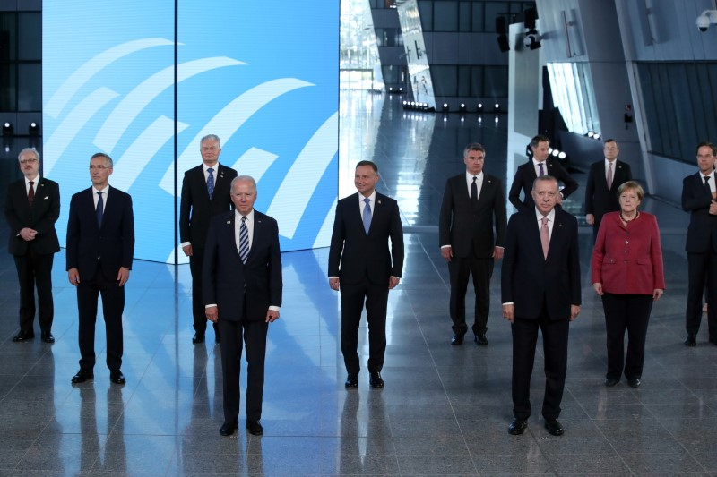 NATO Heads of the states and governments pose for a family photo during the NATO summit at the Alliance's headquarters, in Brussels, Belgium June 14, 2021. REUTERS/Yves Herman/Pool