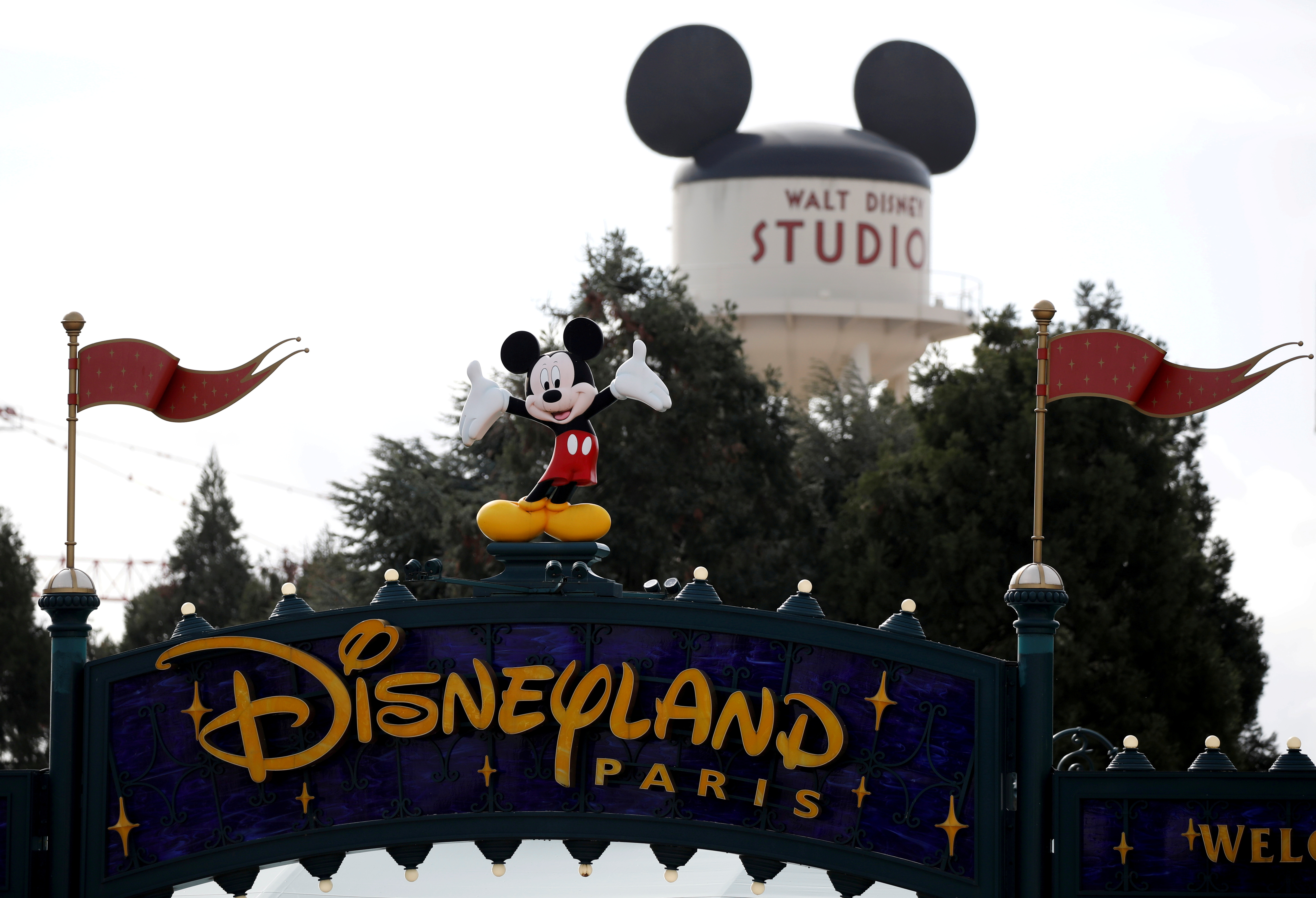 Disney character Mickey Mouse is seen above the entrance of Disneyland Paris, in Marne-la-Vallee, near Paris, France, March 9, 2020.  REUTERS/Benoit Tessier/File Photo