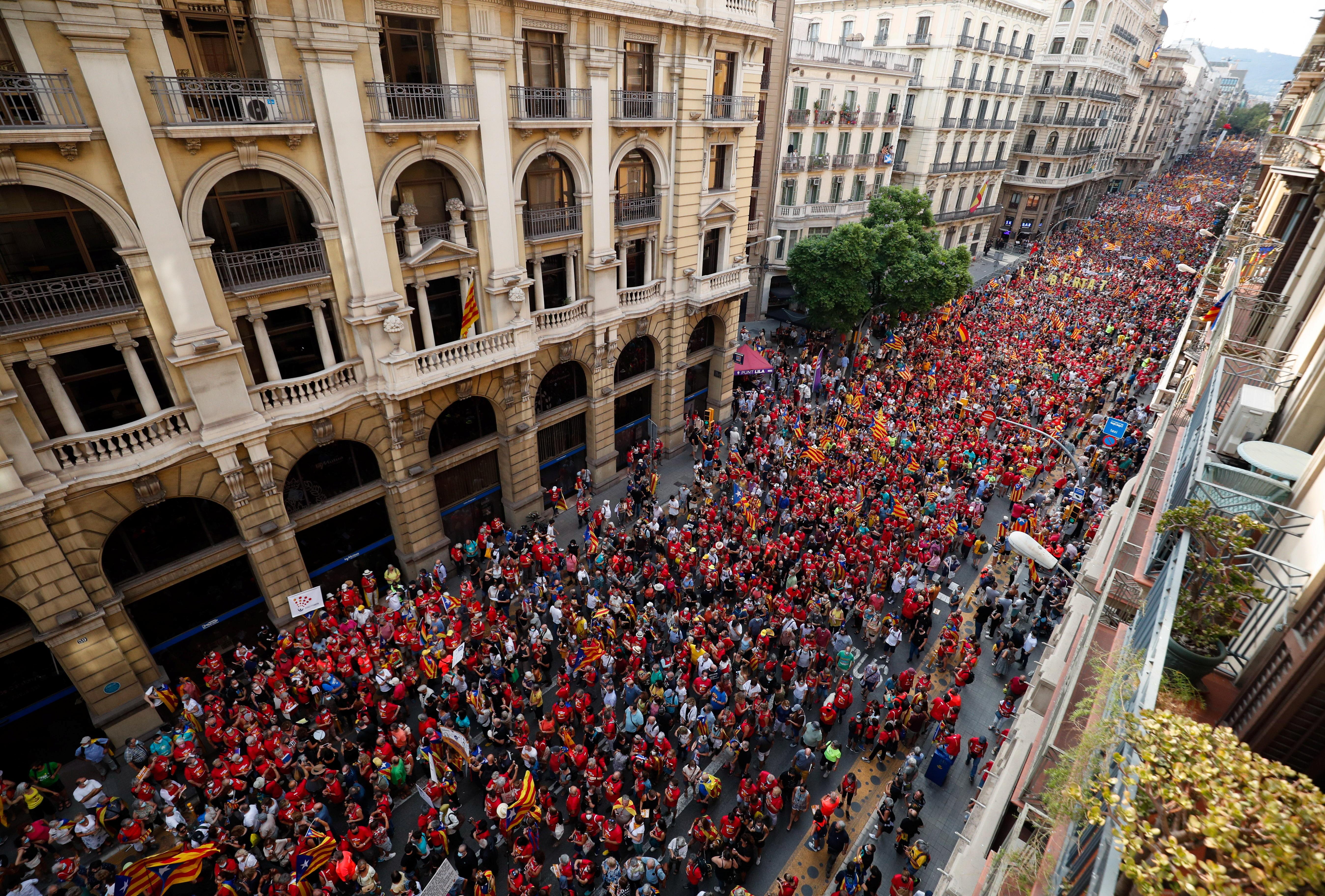 People hold up Estelada flags (Catalan separatist flag) during Catalonia's national day, 'La Diada', in Barcelona, Spain, September 11, 2021. REUTERS/ Albert Gea