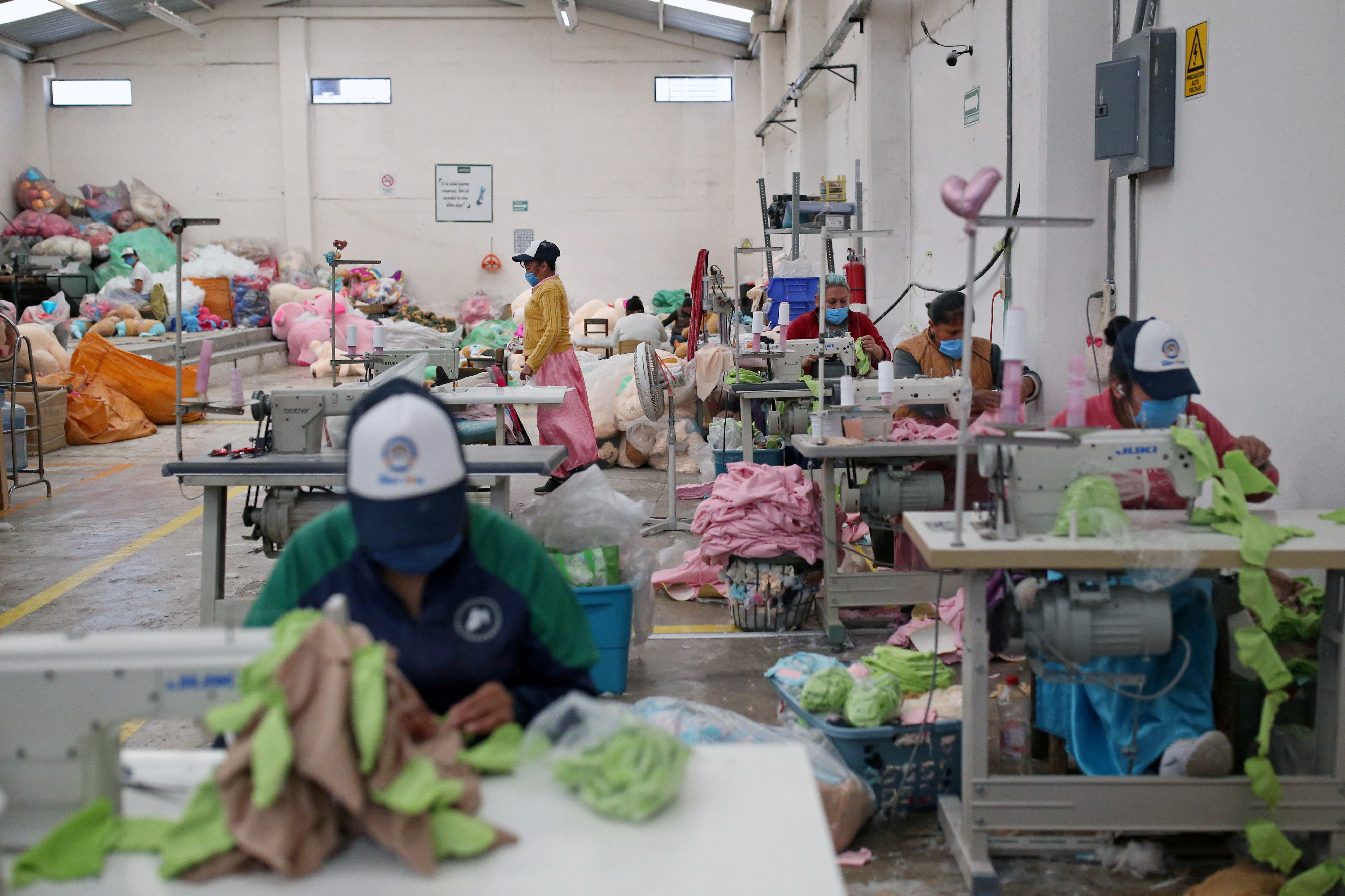 Women work in the manufacture of soft toys at Andy's toy factory in Xonacatlan, as the coronavirus disease (COVID-19) outbreak continues ahead of Valentine's Day in Mexico, February 12, 2021. REUTERS/Edgard Garrido