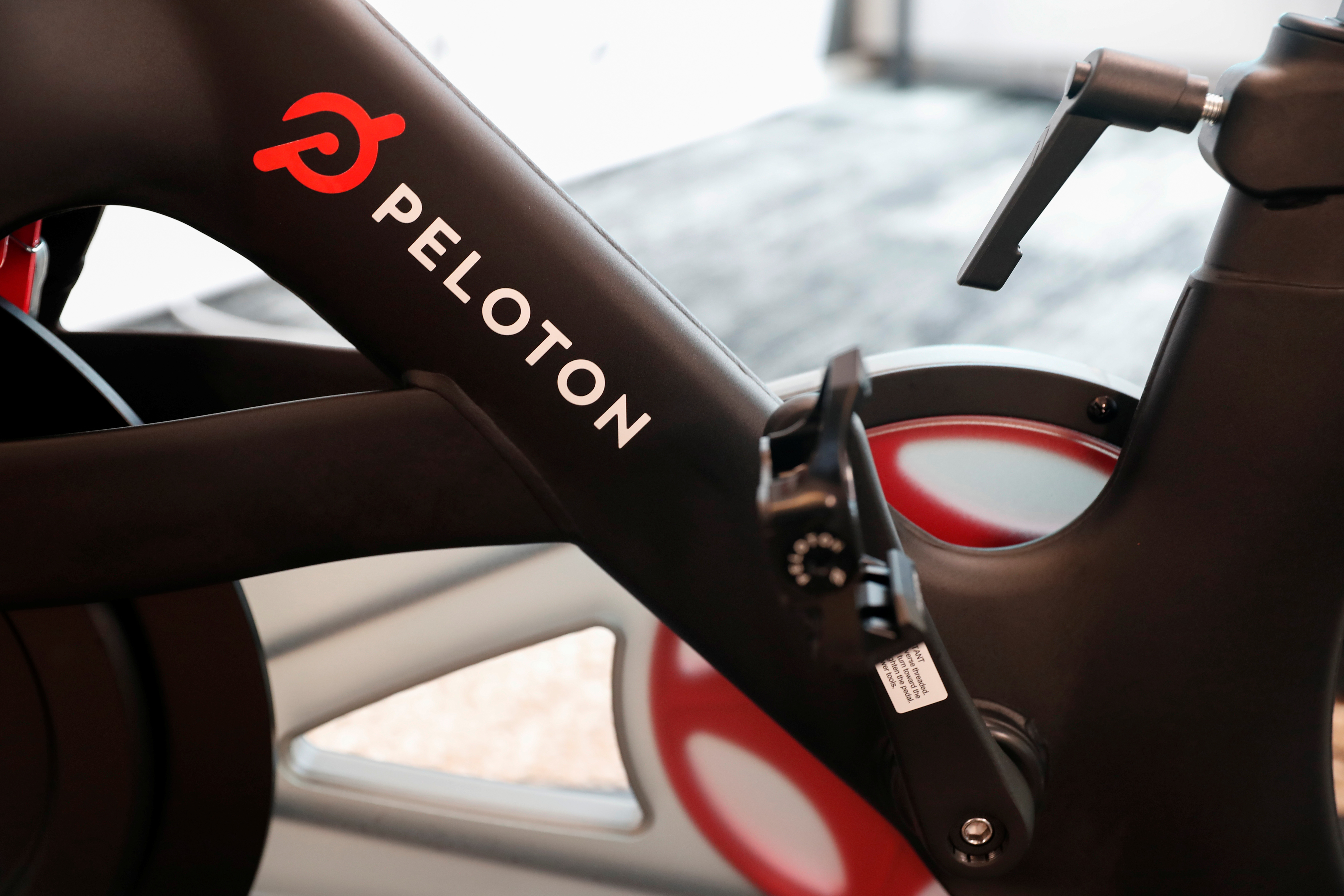 A Peloton exercise bike is seen at the Nasdaq Market site in New York City, September 26, 2019. REUTERS/Shannon Stapleton