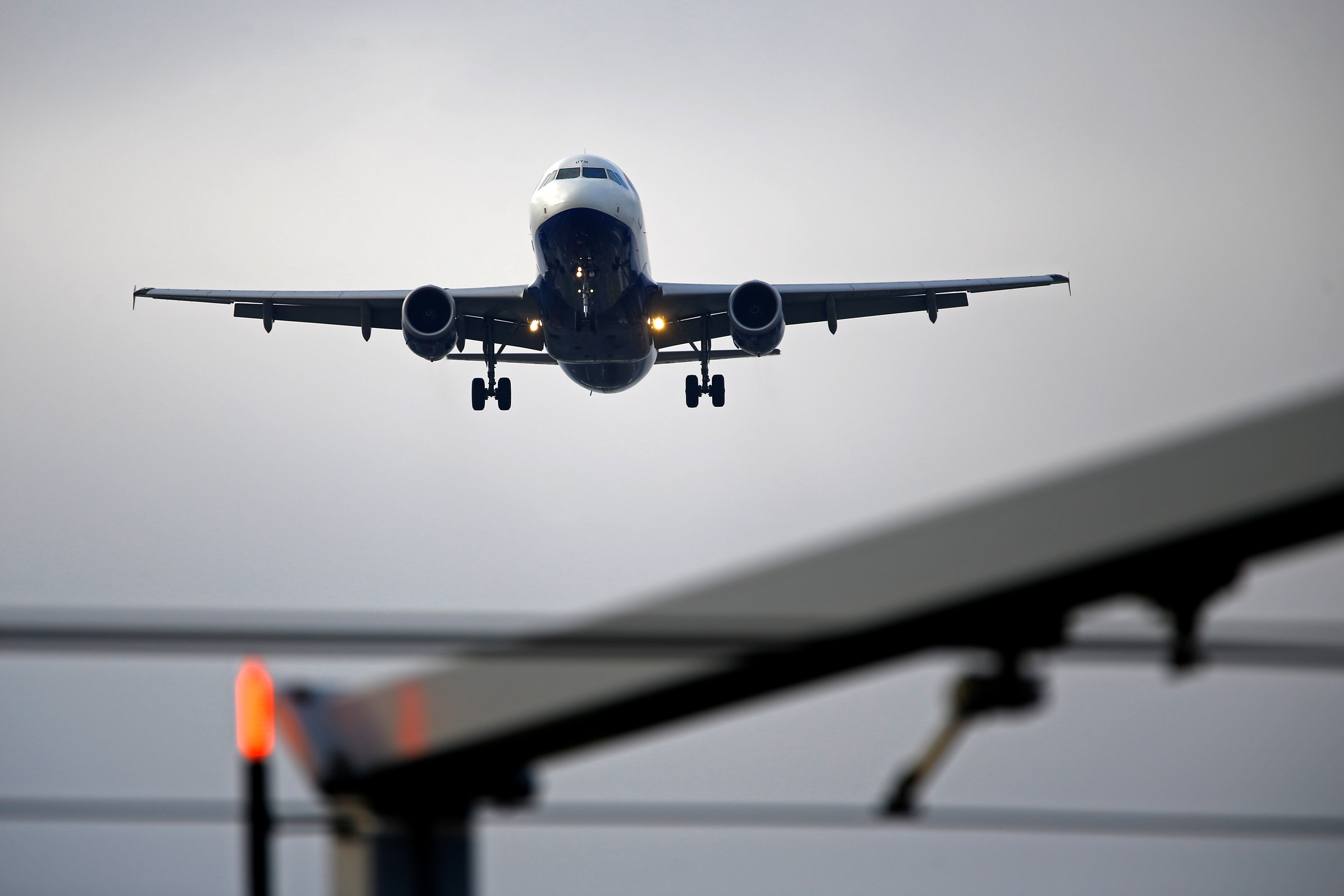 An airplane prepares to land at Cointrin airport in Geneva, Switzerland December 5, 2017. REUTERS/Pierre Albouy/File Photo