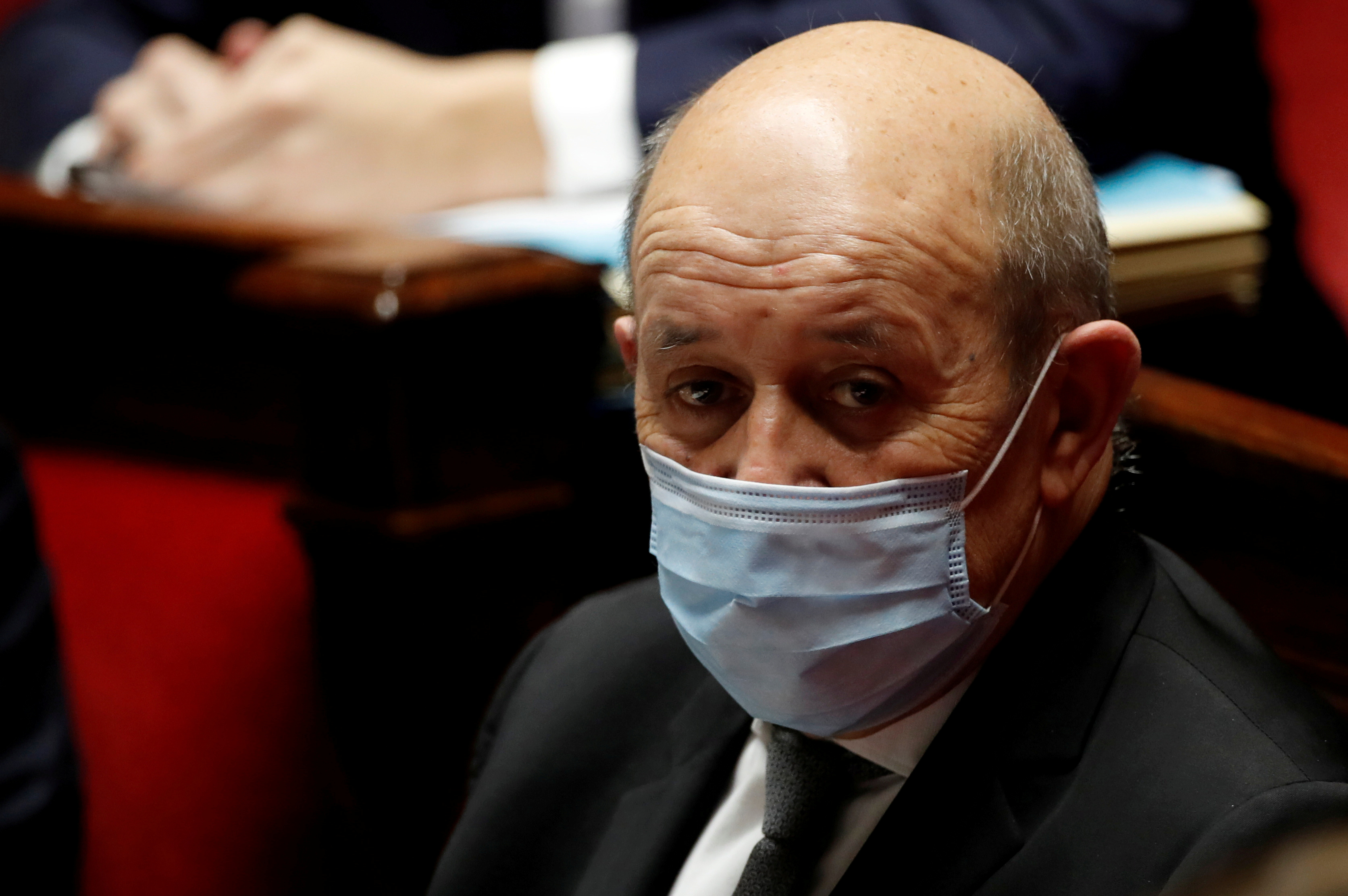 French Foreign Minister Jean Yves Le Drian, wearing a protective face mask, attends the questions to the government session at the National Assembly in Paris amid the coronavirus disease (COVID-19) outbreak in France, January 26, 2021.  REUTERS/Gonzalo Fuentes/File Photo