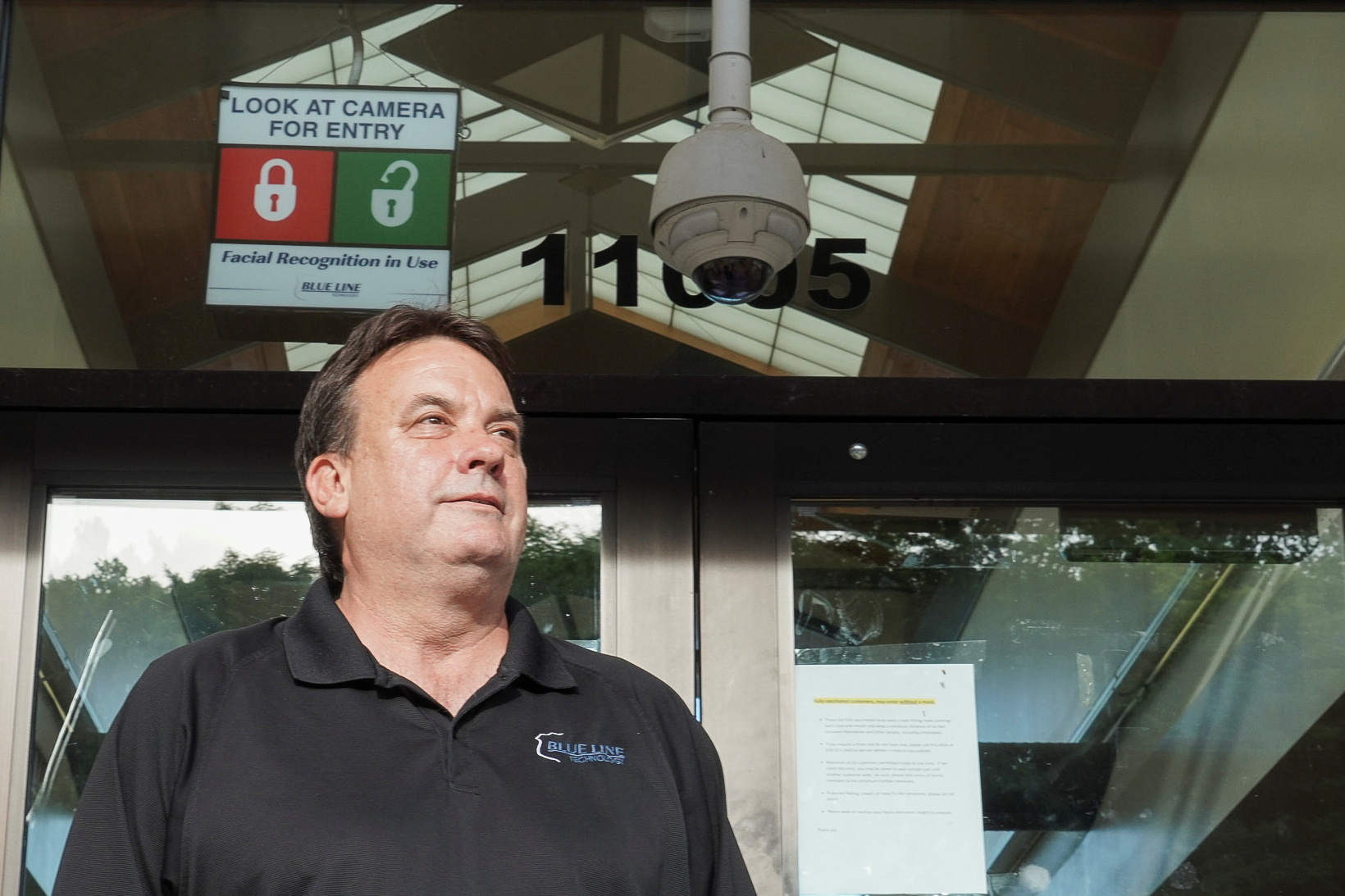 Co-Founder Thomas Sawyer stands in front of his facial recognition system from the company Blue Line Technology, at a convenience store in St. Louis, Missouri, U.S., June 14, 2021. Picture taken June 14, 2021. REUTERS/Lawrence Bryant