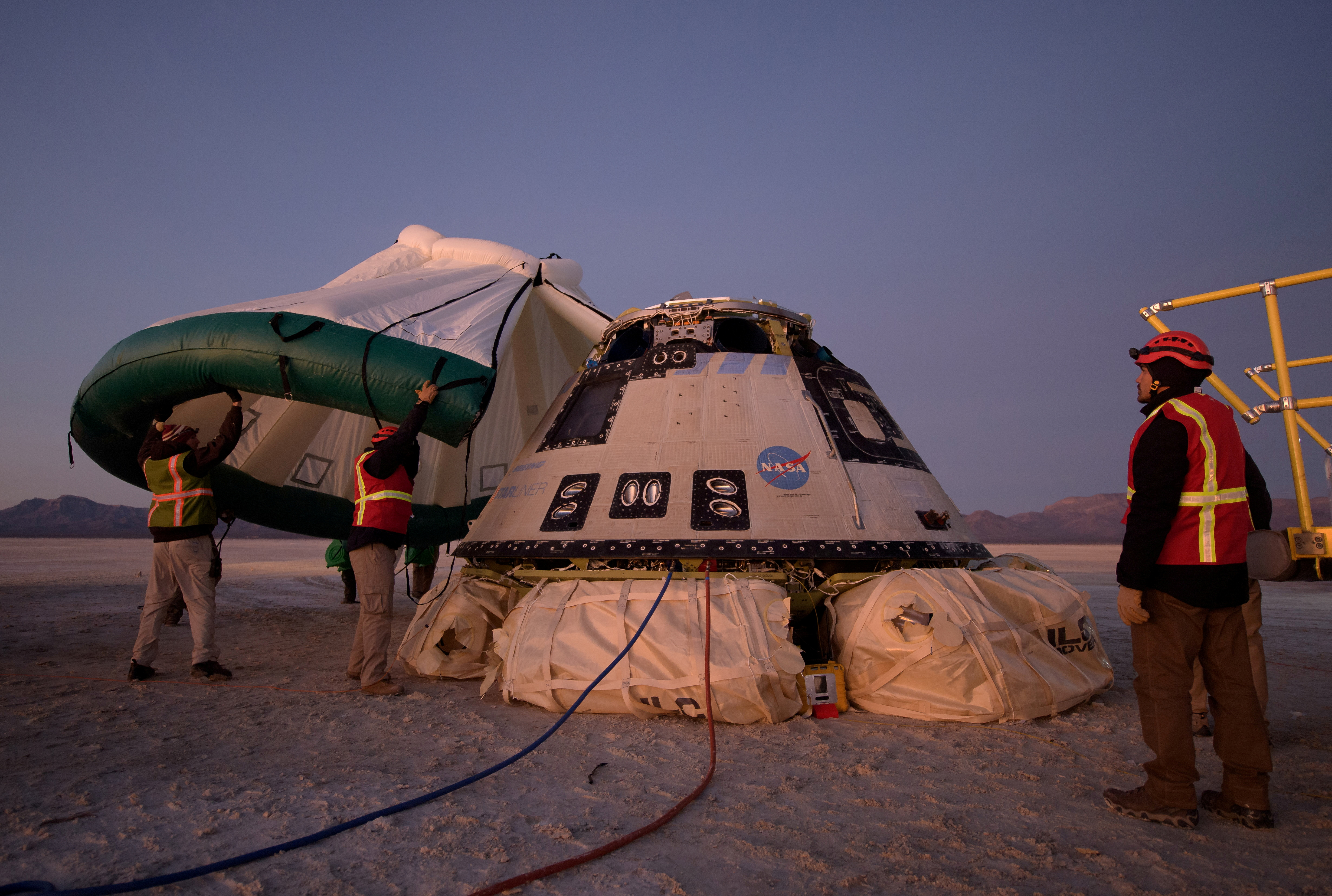 A protective tent is placed over the Boeing CST-100 Starliner spacecraft, which had been launched on a United Launch Alliance Atlas V rocket, after its descent by parachute following an abbreviated Orbital Flight Test for NASA's Commercial Crew programs in White Sands, New Mexico, U.S. December 22, 2019. NASA/Bill Ingalls via REUTERS.  THIS IMAGE HAS BEEN SUPPLIED BY A THIRD PARTY. MANDATORY CREDIT/File Photo