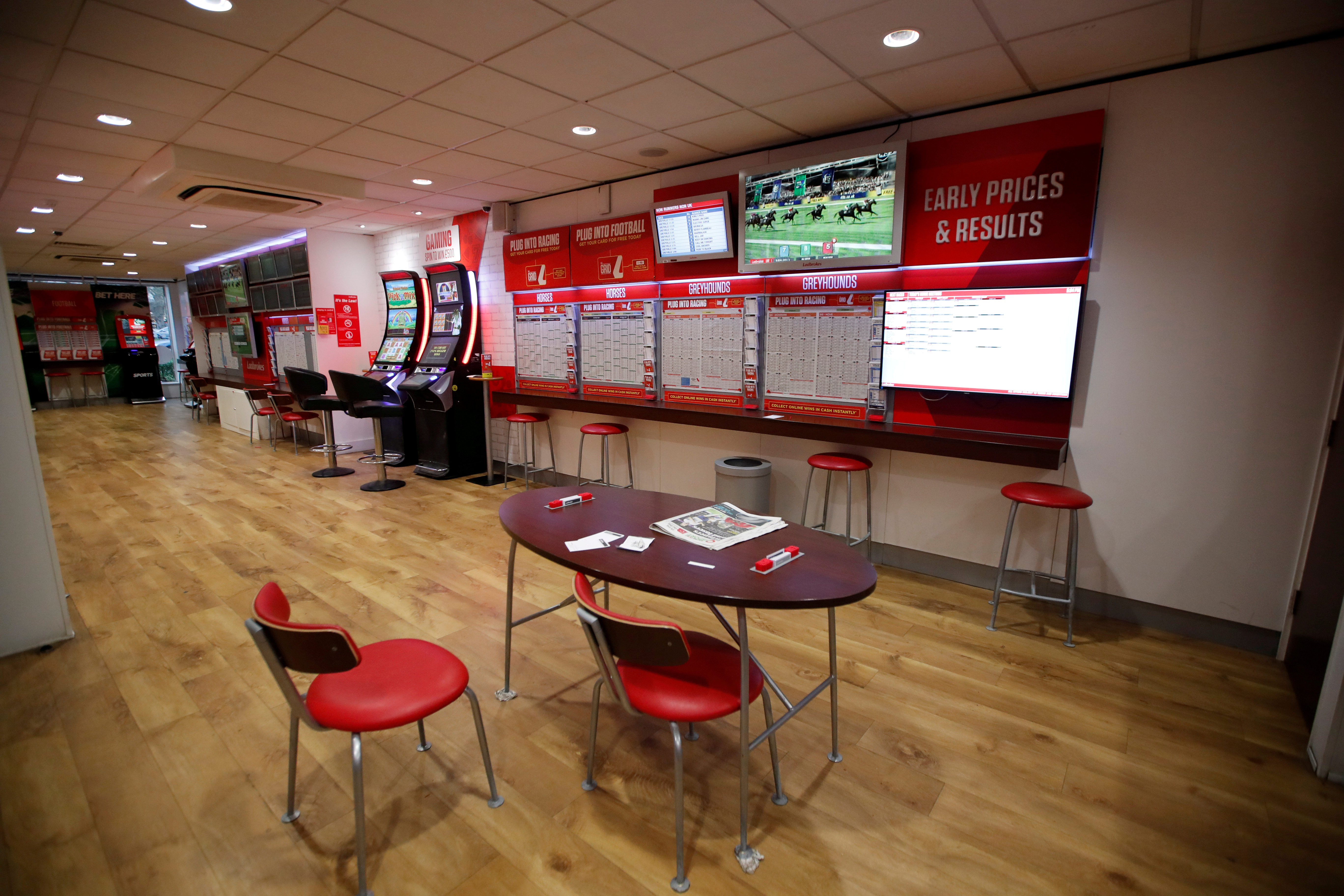 General view inside a deserted Ladbrokes shop in Harpenden as the spread of the coronavirus disease (COVID-19) continues, in Harpenden, Britain, March 18, 2020. REUTERS/Peter Cziborra