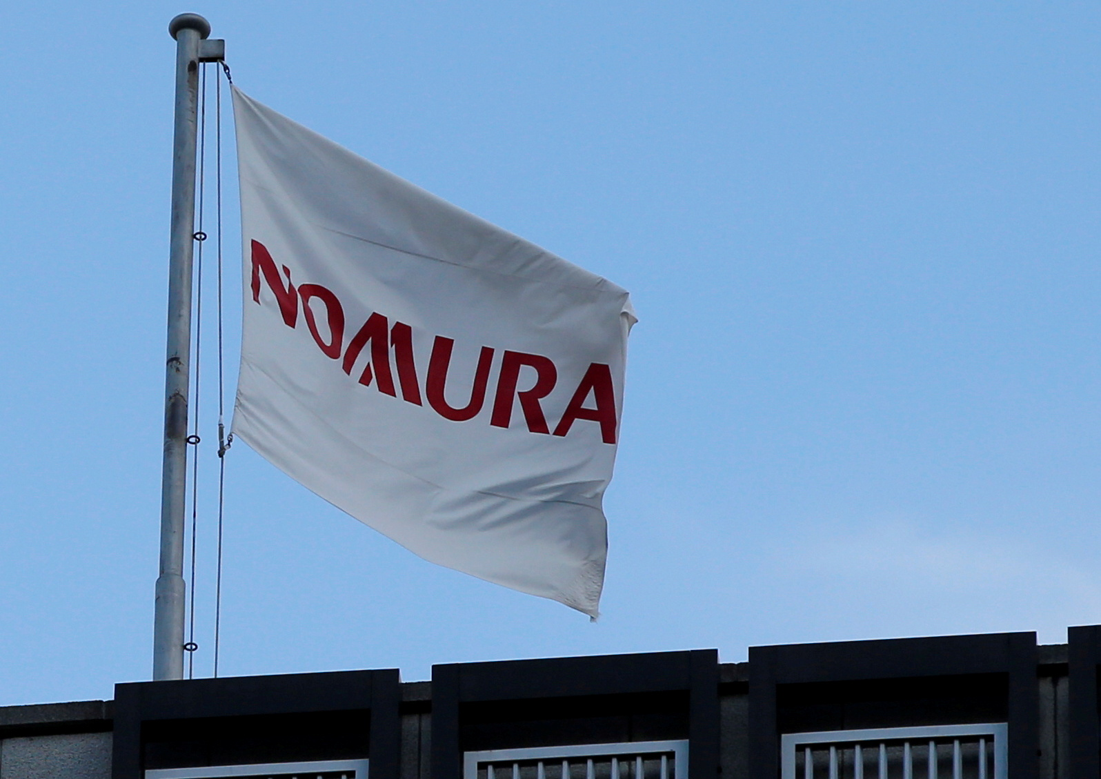 The logo of Japan's Nomura Holdings is seen near the brokerage and investment bank's head office in Tokyo, Japan, Nov. 28, 2016. REUTERS/Toru Hanai