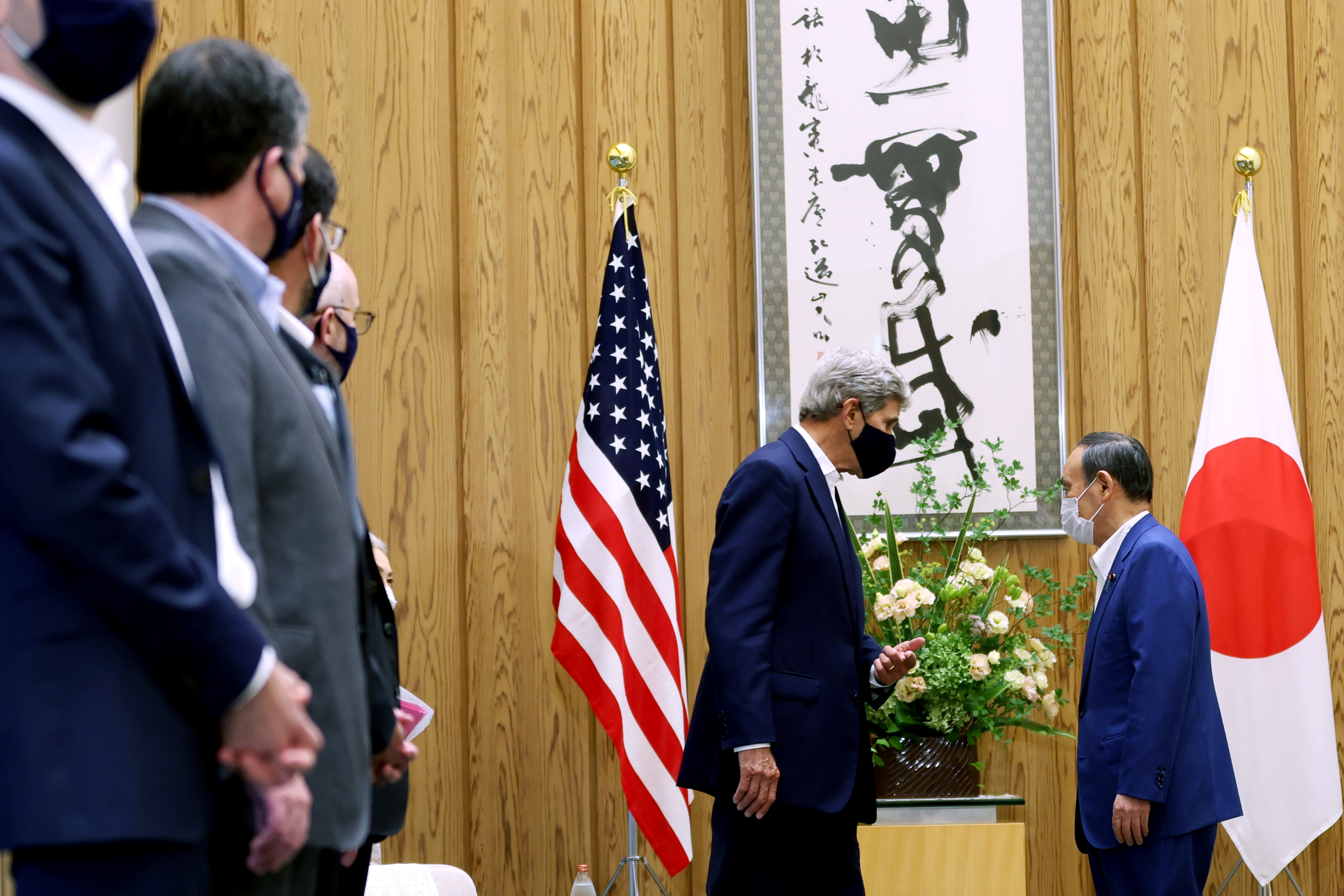 Japan's Prime Minister Yoshihide Suga (R) meets with U.S. special presidential envoy for climate John Kerry in Tokyo, Japan August 31, 2021. Behrouz Mehri/Pool via REUTERS