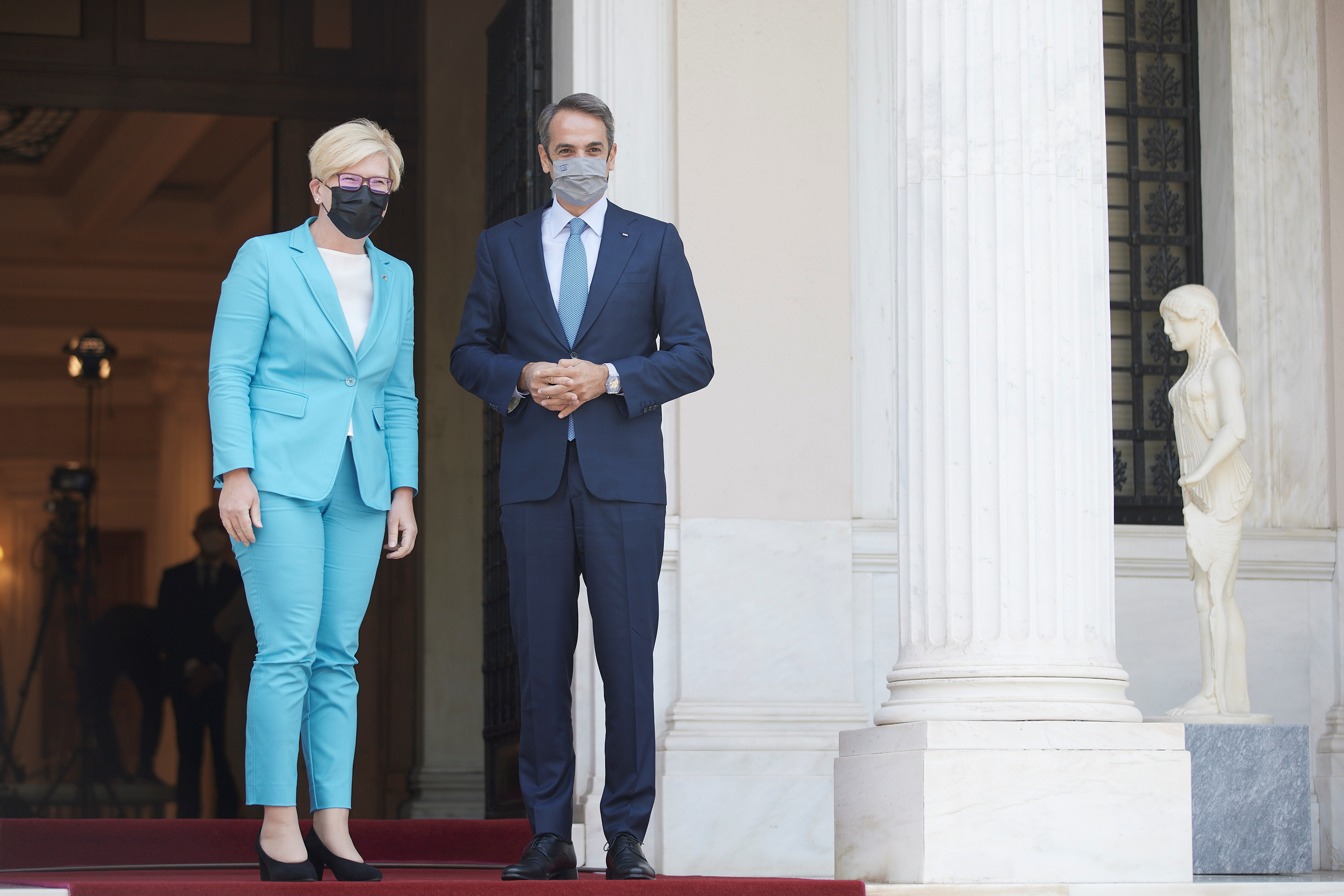 Greek Prime Minister Kyriakos Mitsotakis welcomes his Lithuanian counterpart Ingrida Simonyte at the Maximos Mansion in Athens, Greece, July 15, 2021. Dimitris Papamitsos/Greek Prime Minister's Office/Handout via REUTERS
